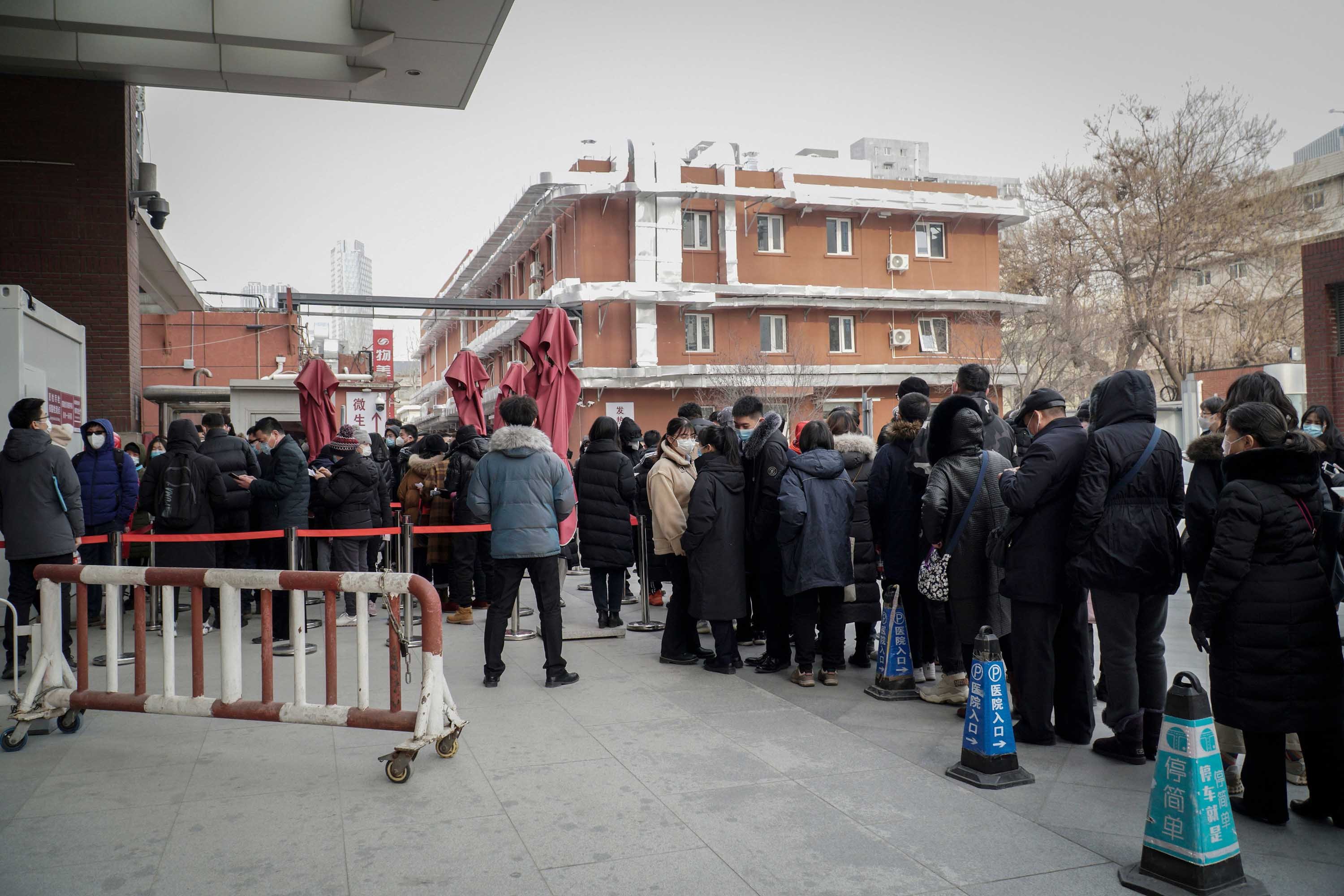 Residents wait to be tested for coronavirus after new confirmed cases were detected in Beijing, on December 28.
