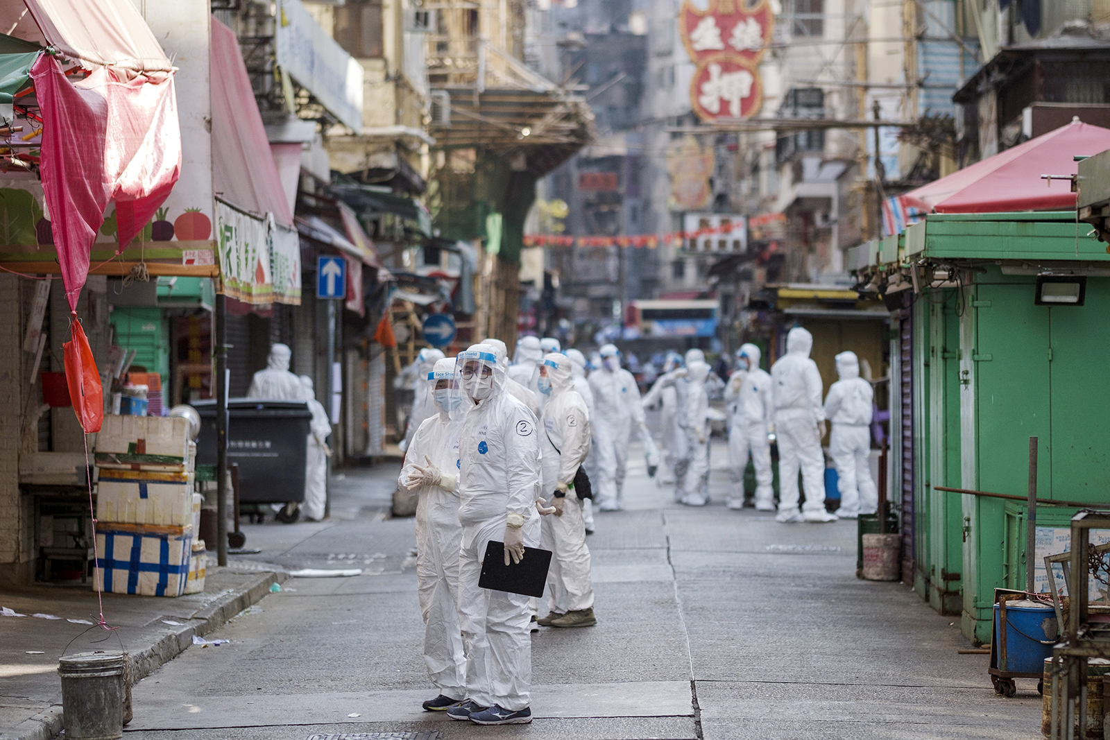 Government workers wearing personal protective equipment in the locked-down Jordan neighborhood of Hong Kong, on January 23.
