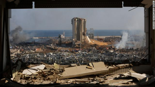 Smoke rises above wrecked buildings at the city's port on August 5, 2020 in Beirut, Lebanon.