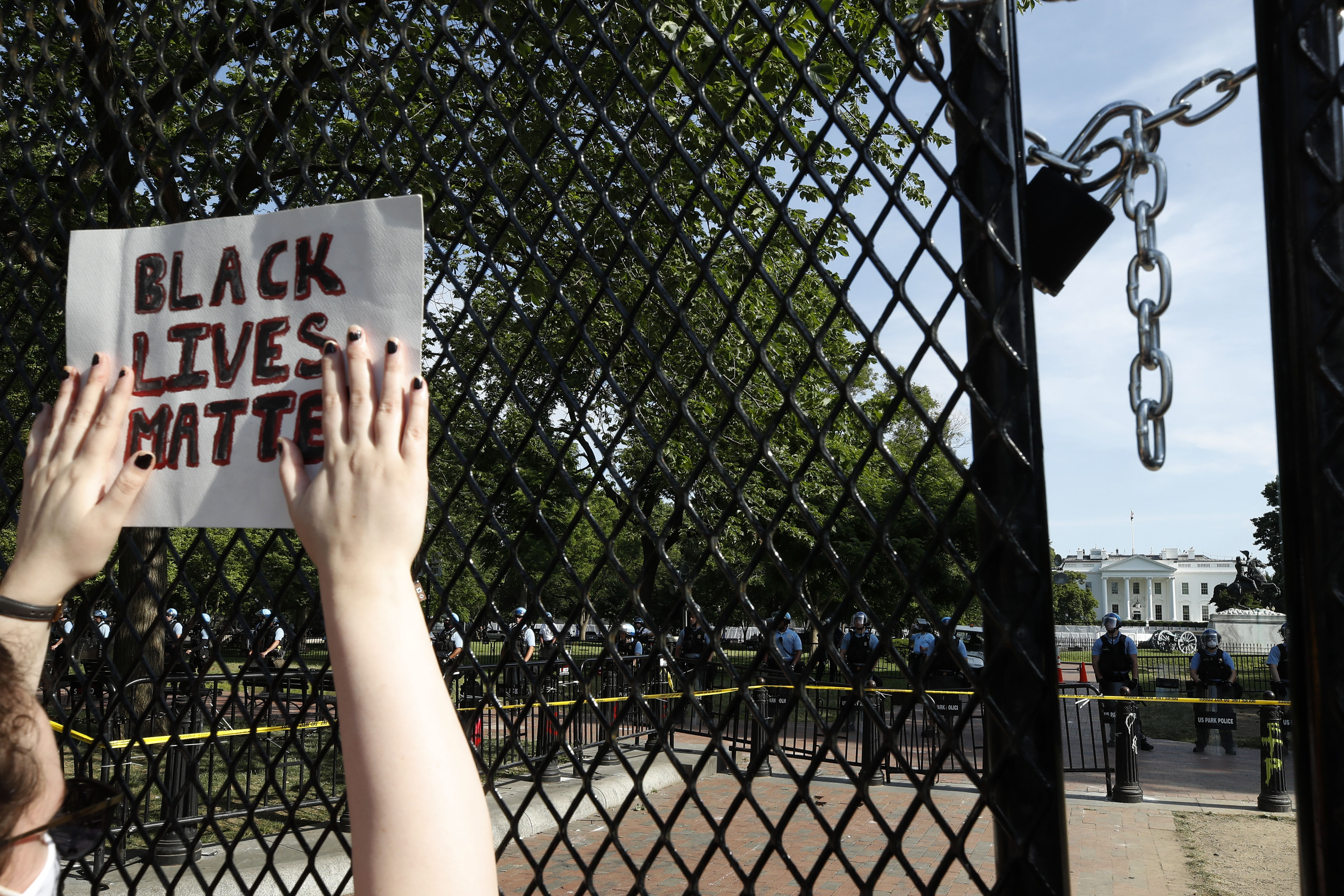 A person protests behind a fence near the White House on June 2.