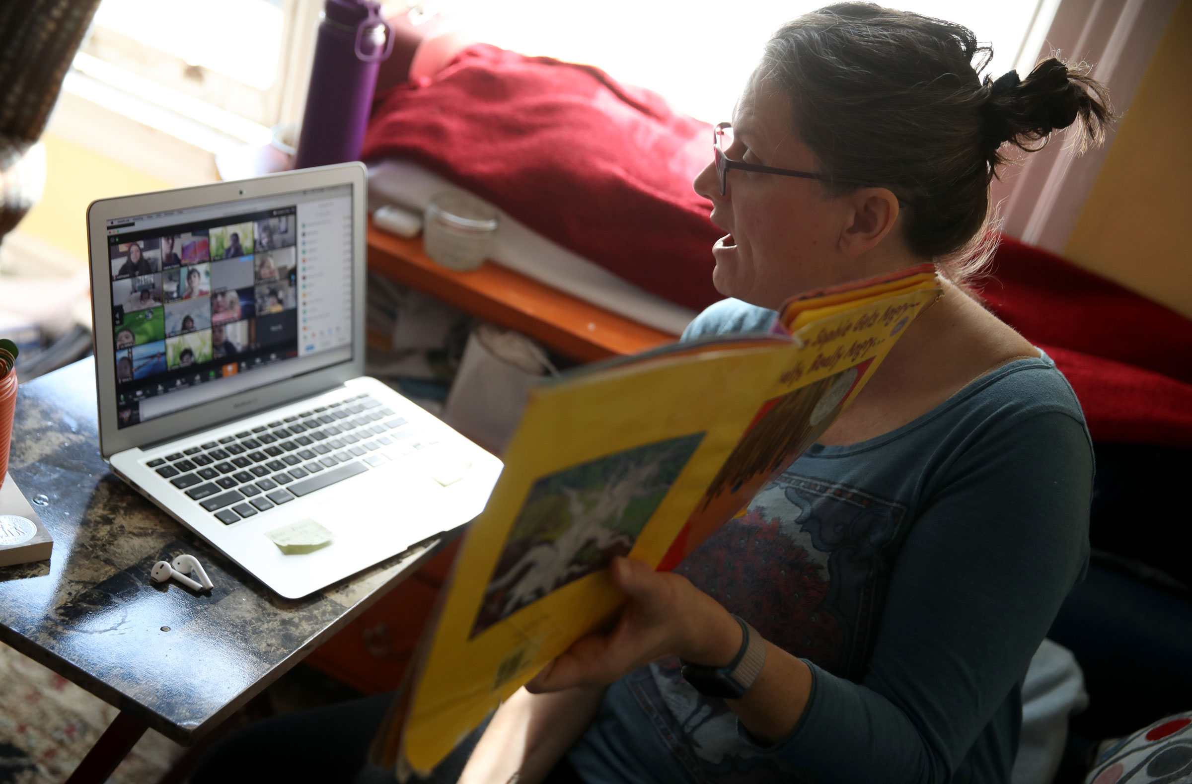 Leanne Francis, a first-grade teacher at Harvey Milk Civil Rights Academy, conducts an online class from her living room in San Francisco on March 20.
