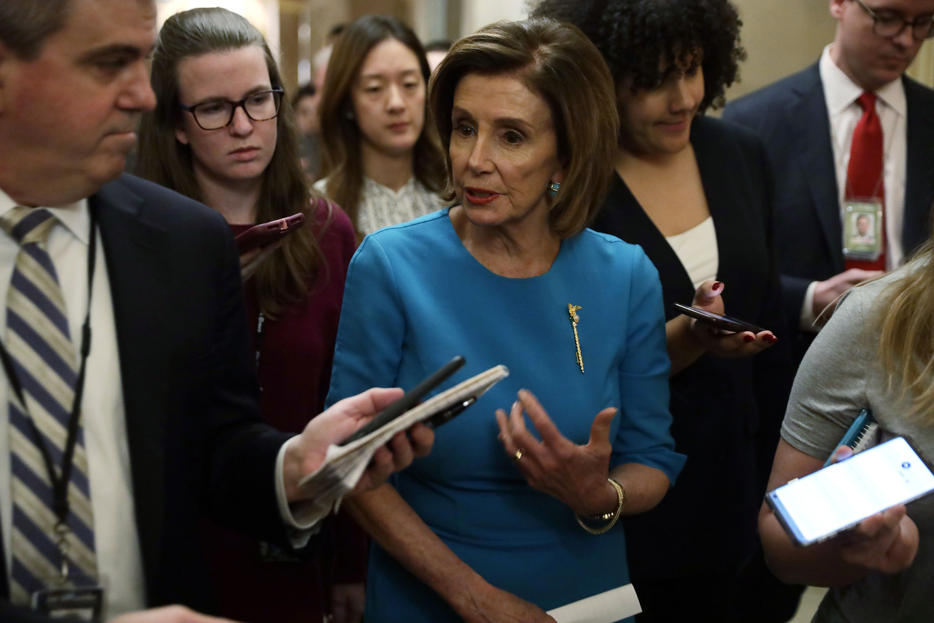 Speaker Pelosi speaks to the press on March 13.