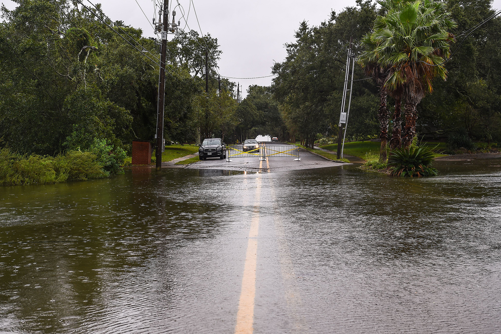 Water floods on the road near the marina hours before Hurricane Sally makes landfall on the US Gulf Coast in Pascagoula, Mississippi on Tuesday.