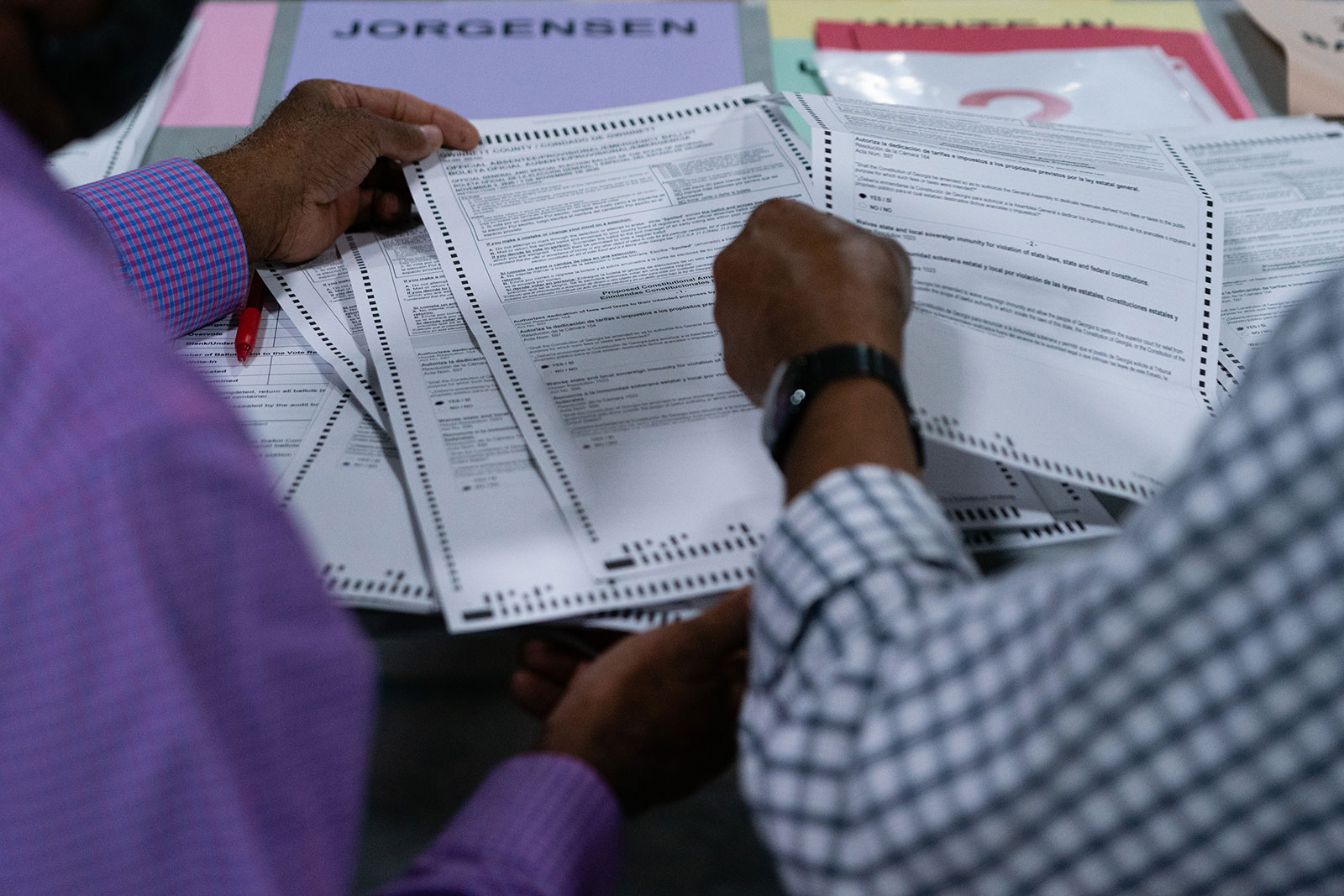 People hand count ballots during an audit at the Gwinnett County Voter Registration office in Lawrenceville, Georgia, on November 13.