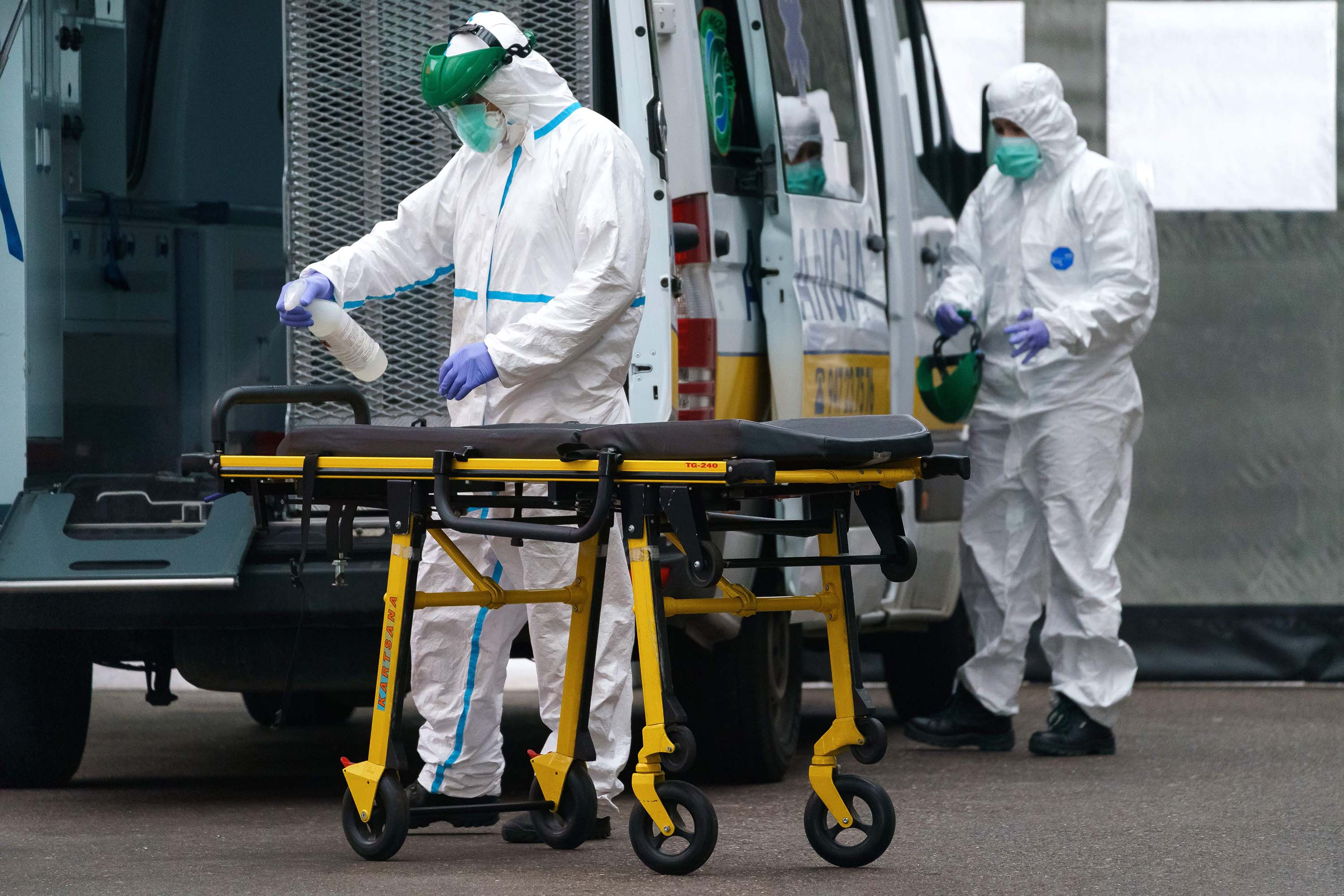 Paramedics disinfect a stretcher outside the Burgos Hospital in northern Spain on April 2.