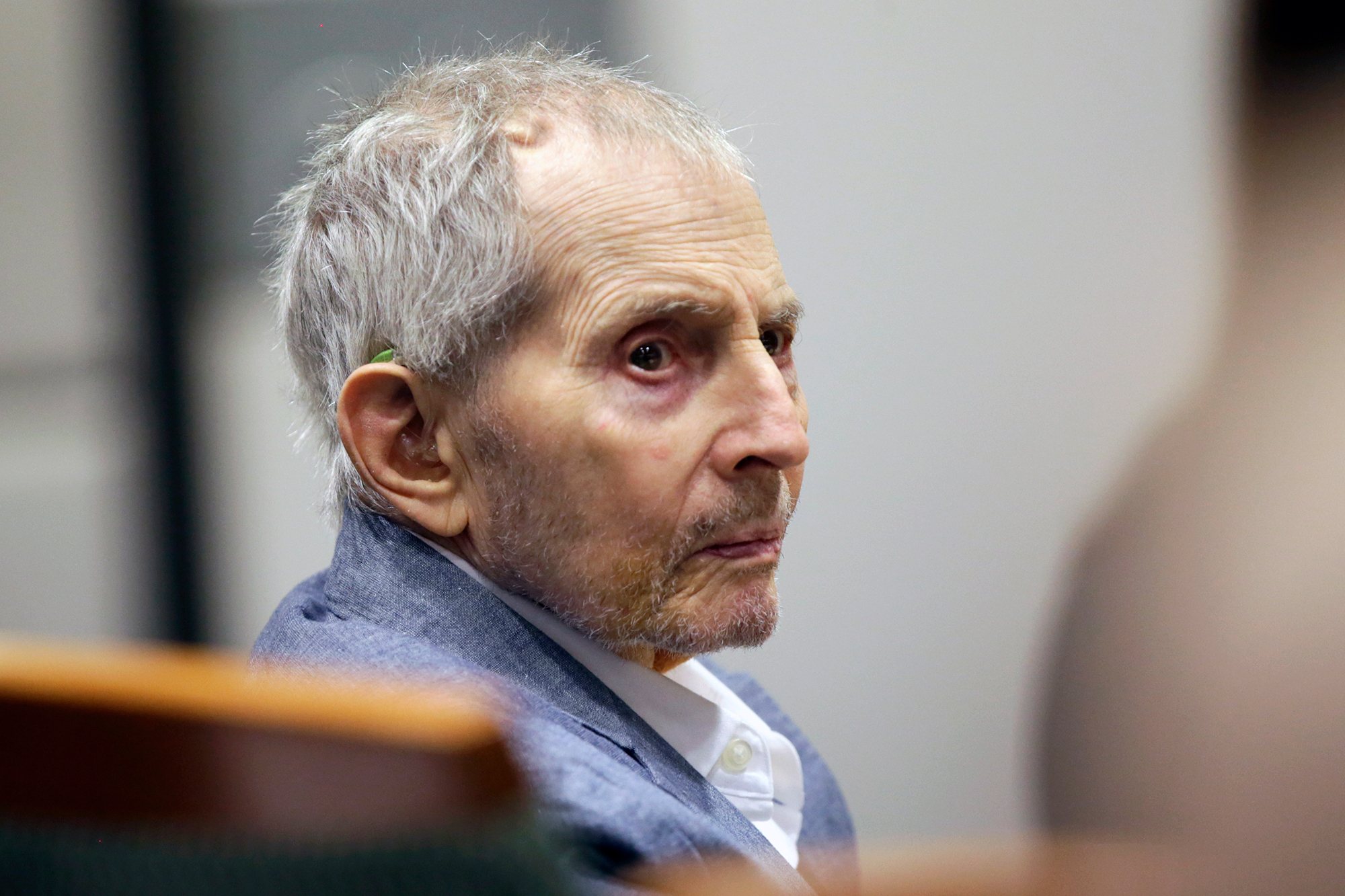 Real estate heir Robert Durst looks over during his murder trial on March 10, 2020 in Los Angeles, California.
