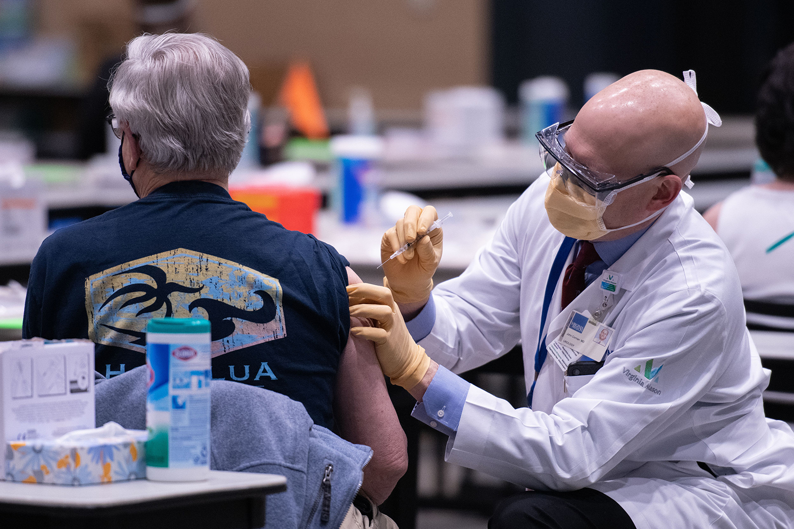 Chief clinical officer John Corman MD at Virginia Mason administers a dose of the Pfizer Covid-19 vaccine at the Amazon Meeting Center in downtown Seattle, Washington on January 24.