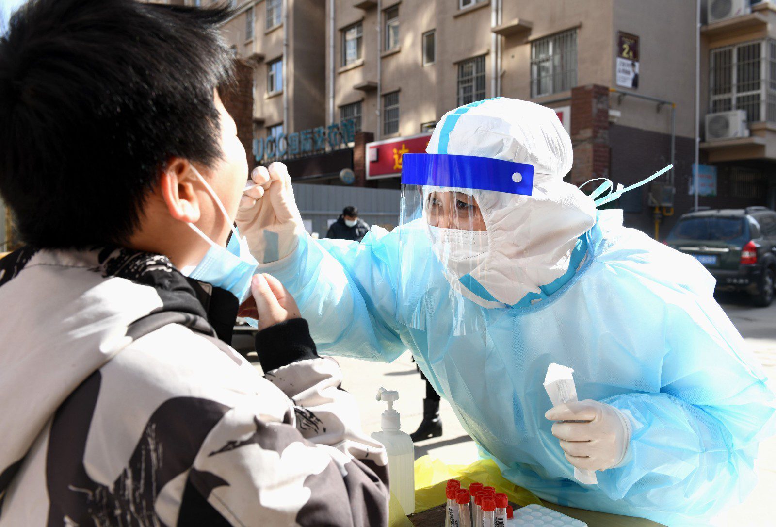 A medical staff member takes a throat swab sample for nucleic acid detection in Xinle City, China, on February 5.