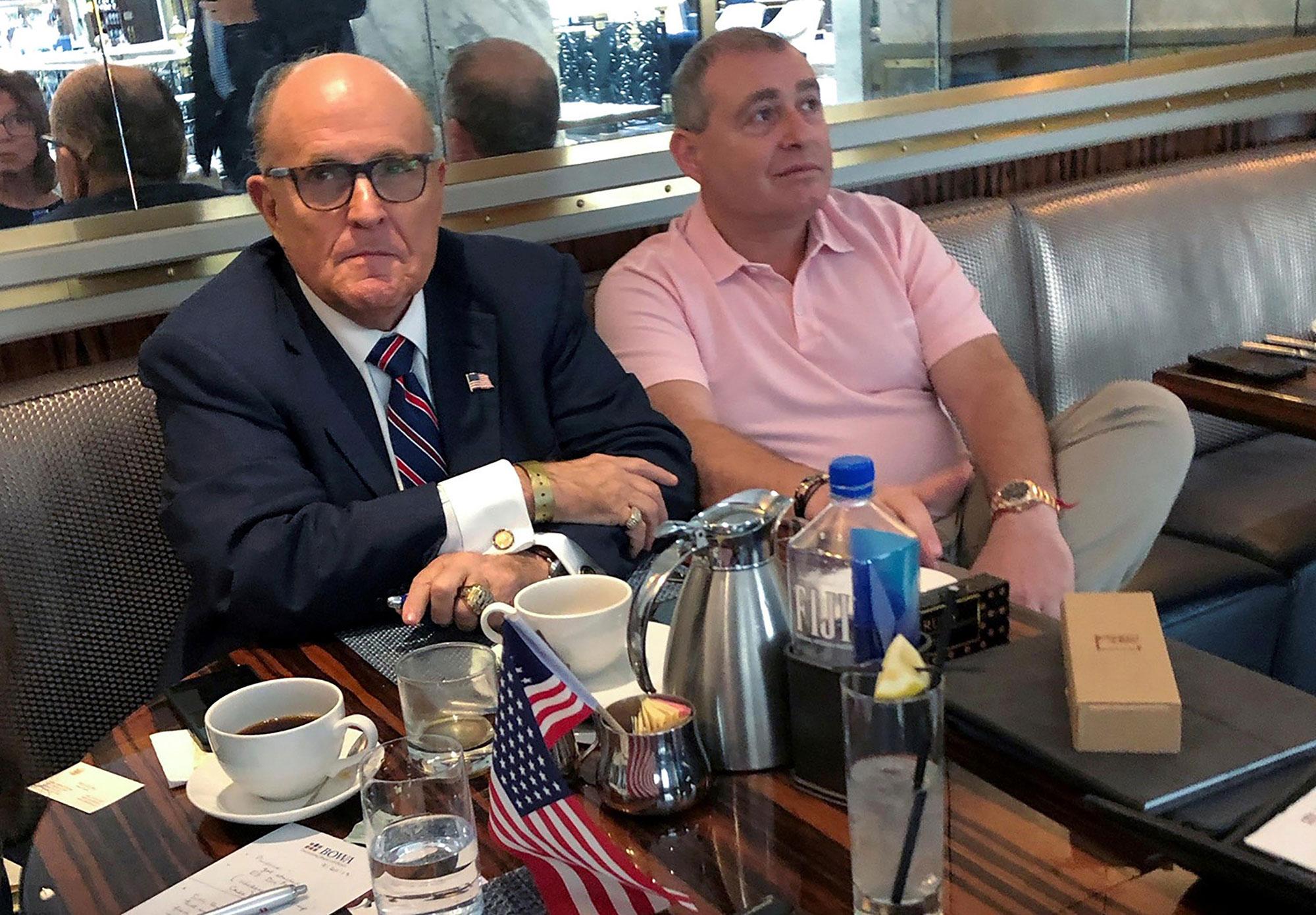 President Trump's personal lawyer Rudy Giuliani has coffee with Ukrainian-American businessman Lev Parnas at the Trump International Hotel in Washington, Sept. 20.