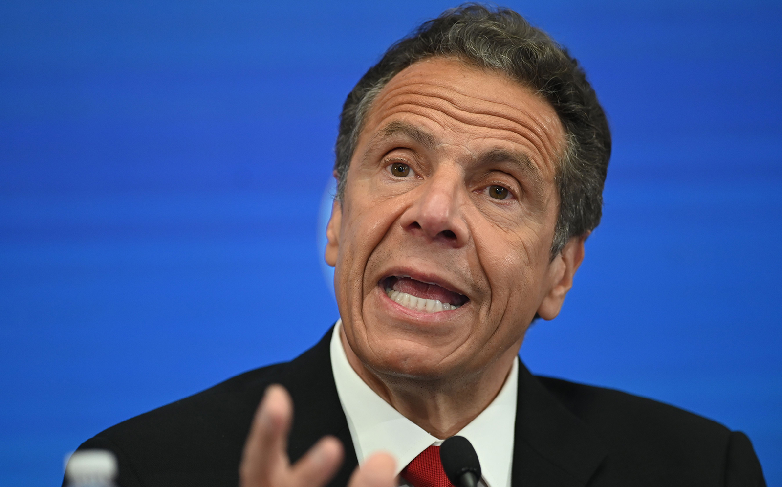 Governor of New York Andrew Cuomo speaks during a press conference at the New York Stock Exchange on May 26, at Wall Street in New York City.