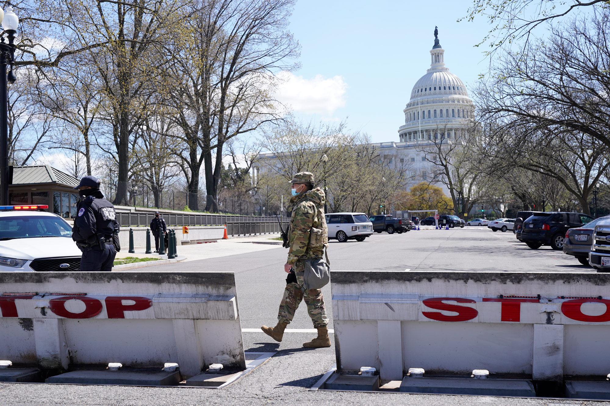 Troops stand guard at a barrier on Capitol Hill in Washington, DC, on April 2.