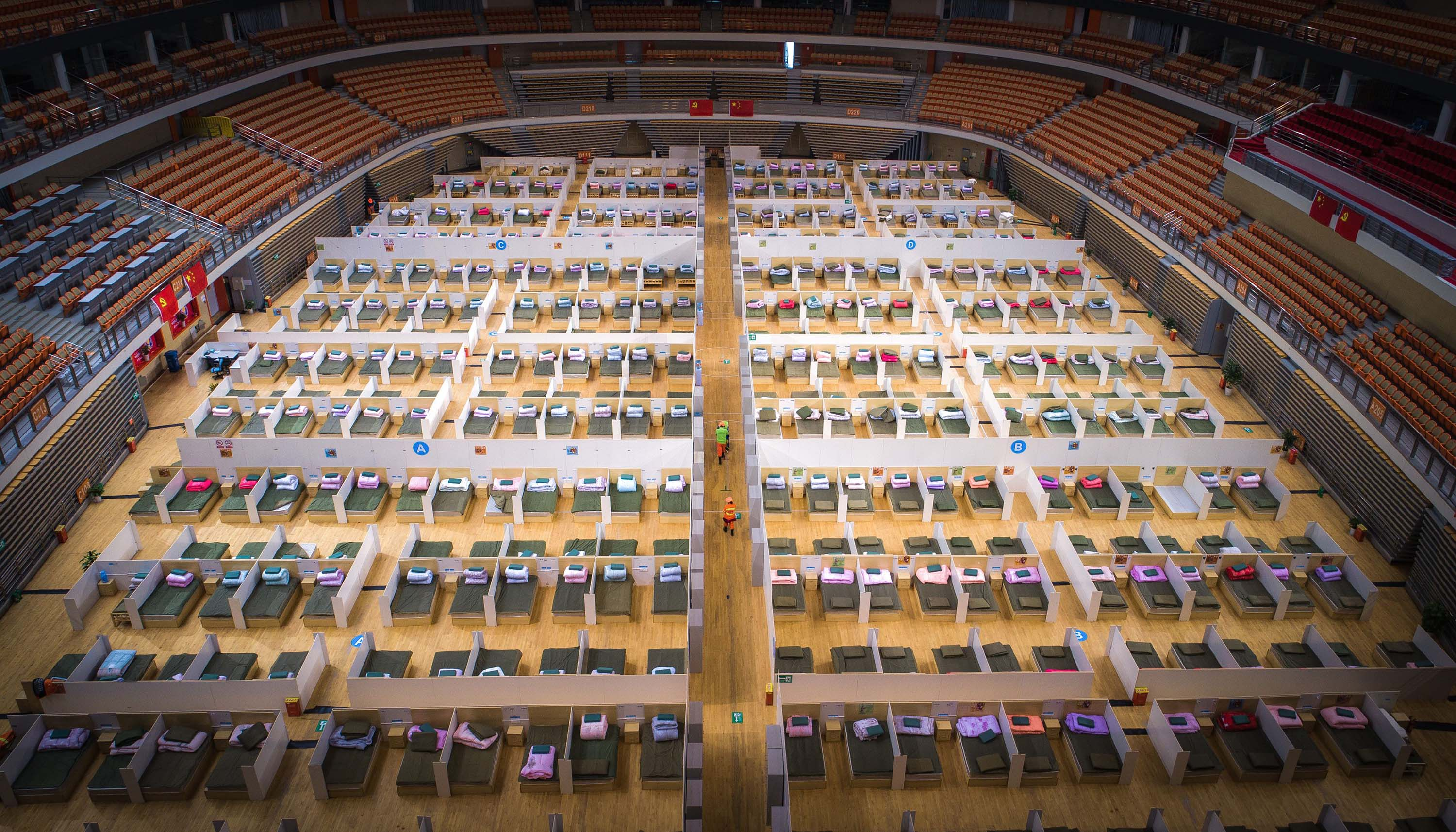 Beds are made in the Wuhan Sports Center, which has been converted into a temporary hospital in Wuhan, China.