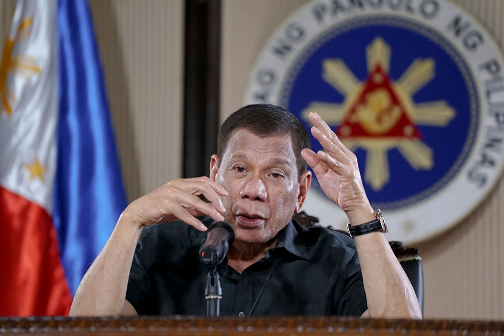 In this photo provided by the Malacanang Presidential Photographers Division, Philippine President Rodrigo Duterte gestures as he addresses the nation during a live broadcast in Malacanang, Manila, Philippines on March 30.