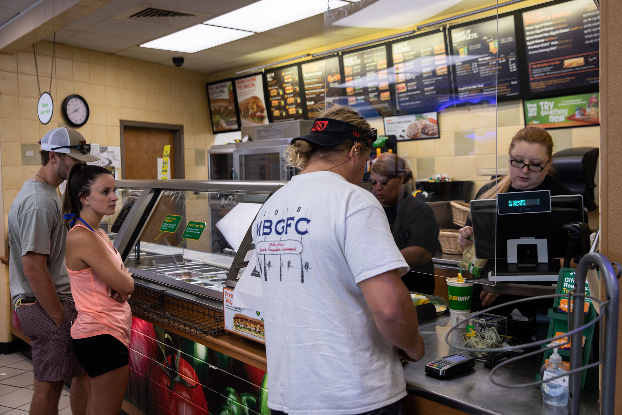 Customers wait in line to place orders at a fast food restaurant in Dauphin Island, Alabama, on May 1.