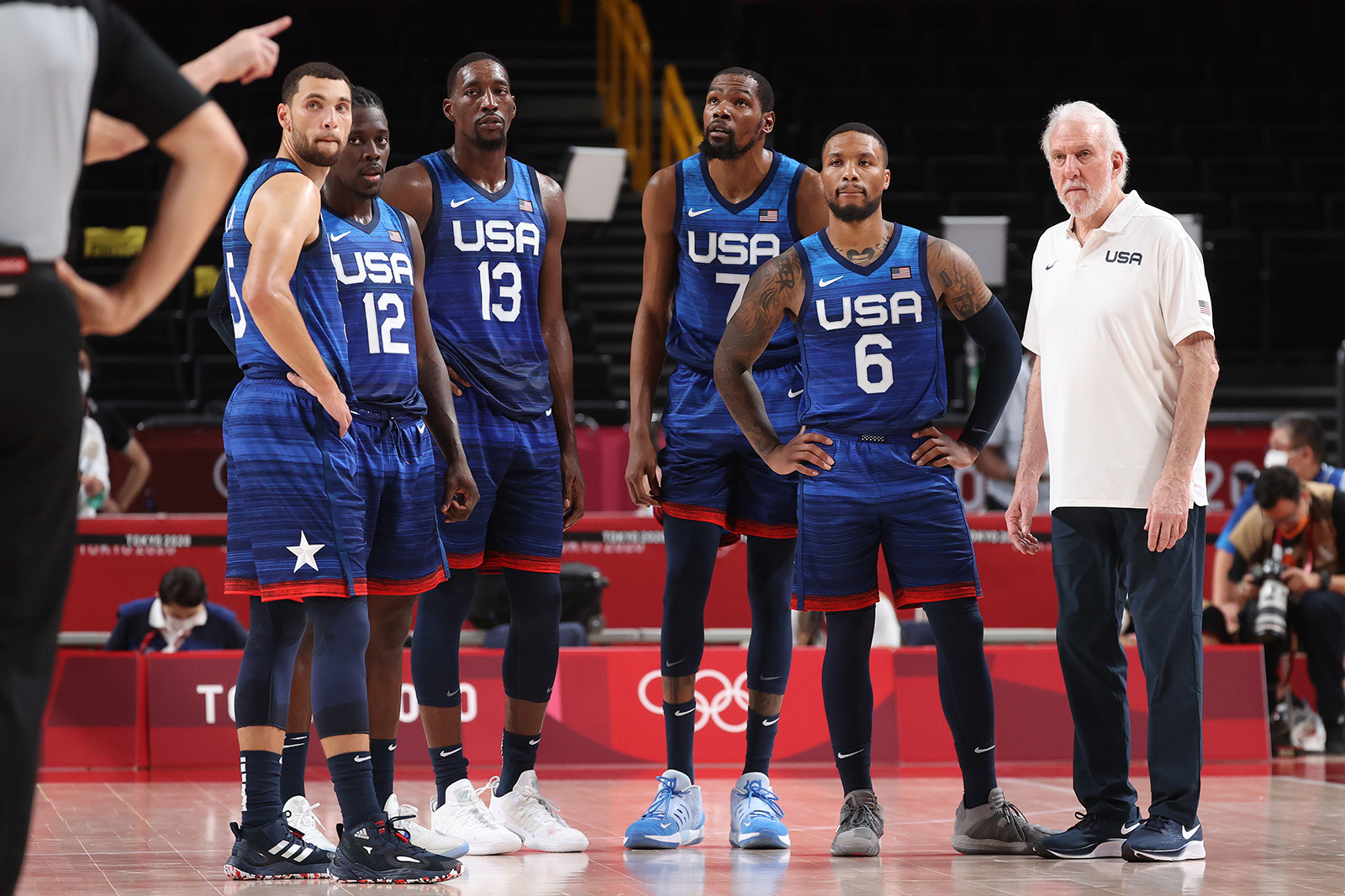 Zachary Lavine, Jrue Holiday, Bam Adebayo, Kevin Durant, Damian Lillard and Head Coach Gregg Popovich of Team USA during their game against France on Sunday, July 25.