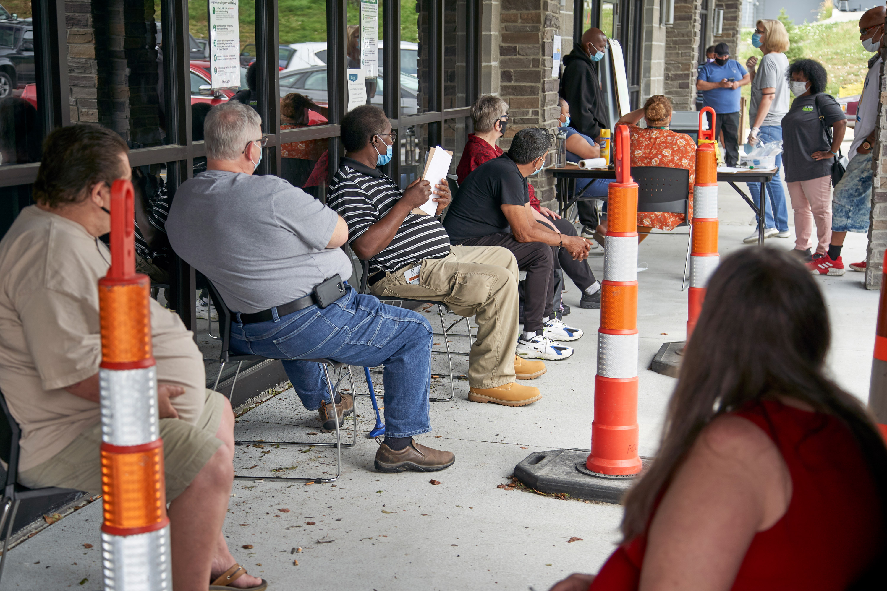 People wait to be called into the Heartland Workforce Solutions office in Omaha, Nebraska on July 15.