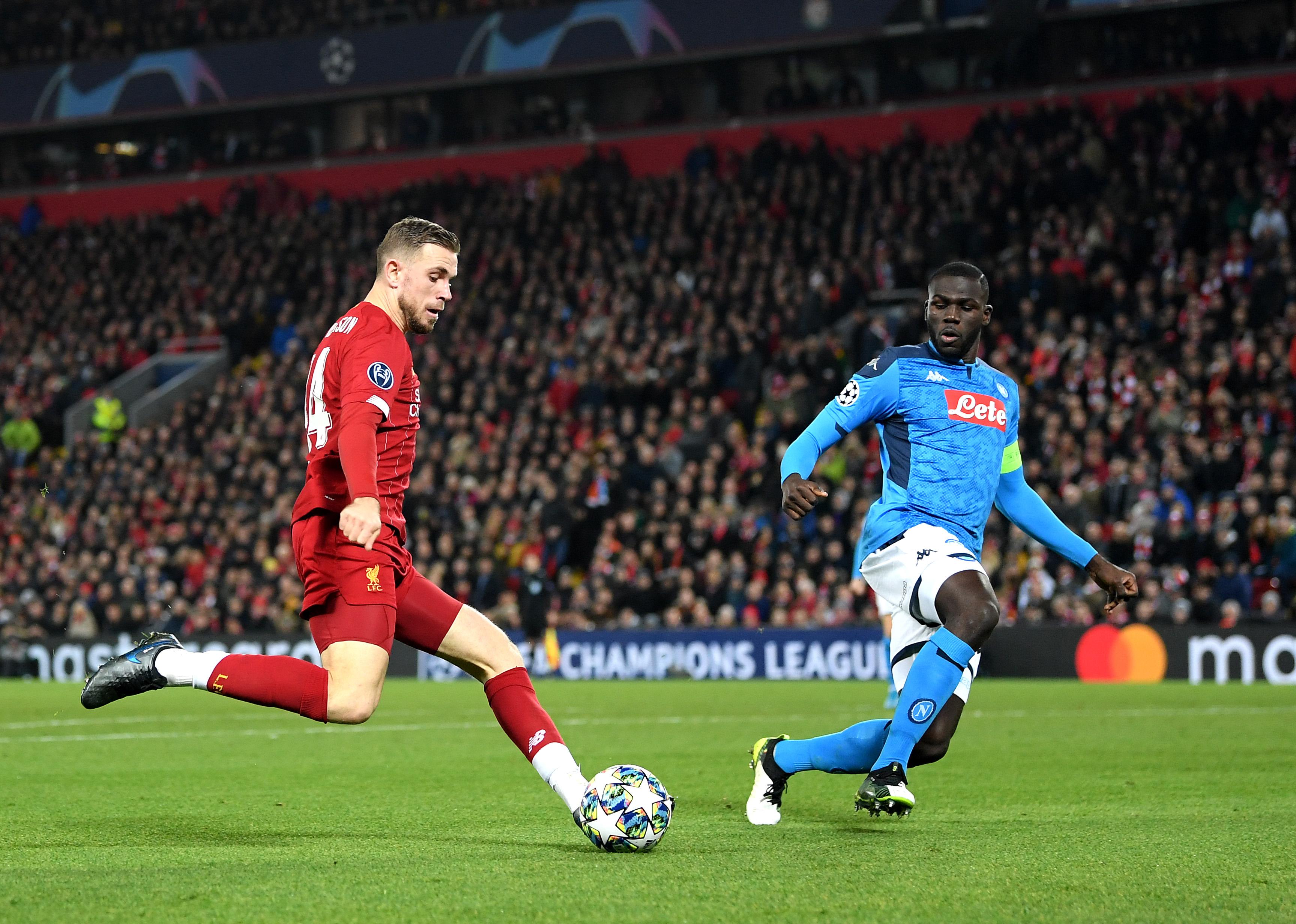 Jordan Henderson of Liverpool is put under pressure by Napoli's Kalidou Koulibaly.