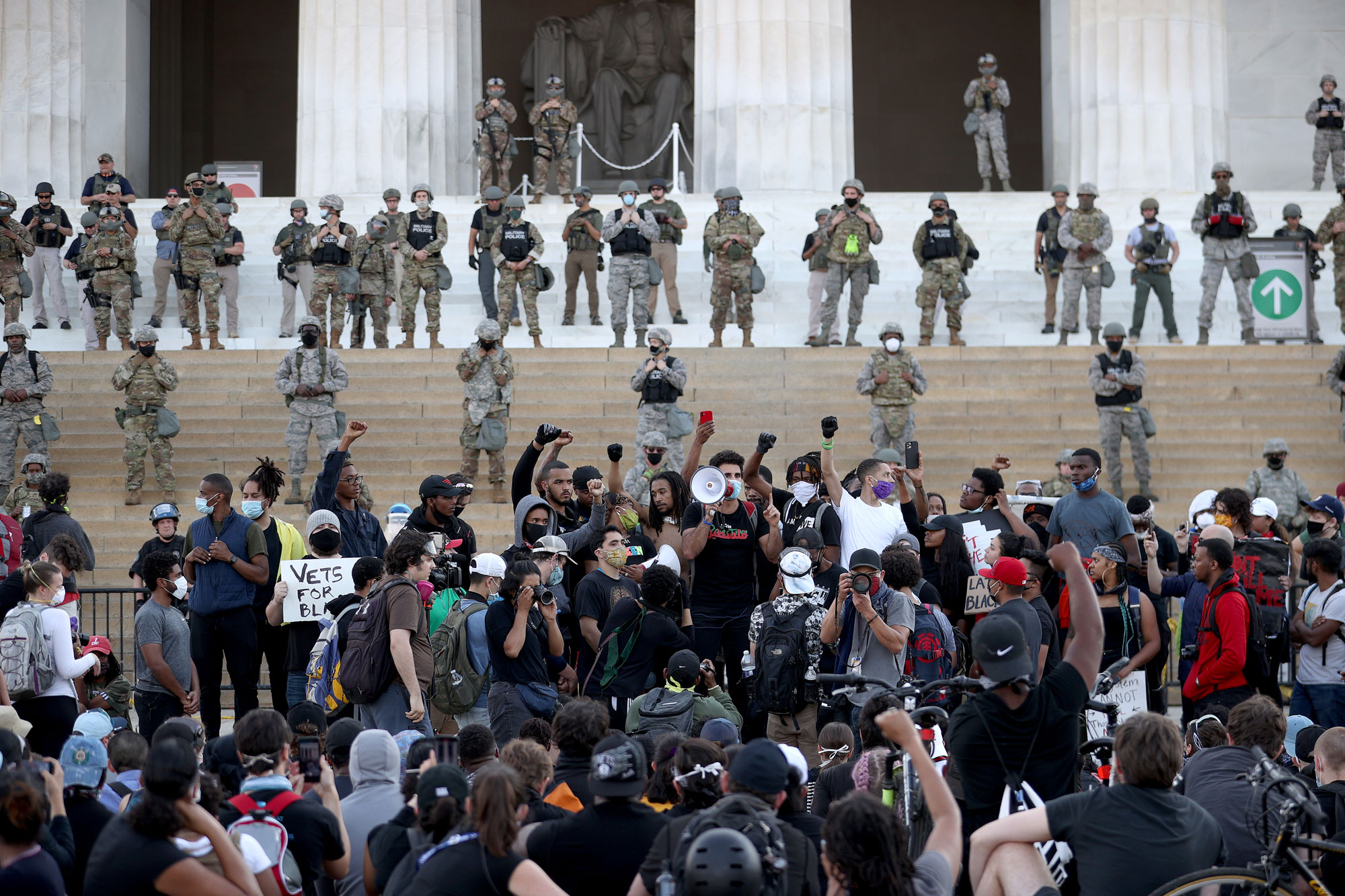 Members of the D.C. National Guard stand on the steps of the Lincoln Memorial monitoring demonstrators during a peaceful protest against police brutality and the death of George Floyd, on June 2 in Washington.