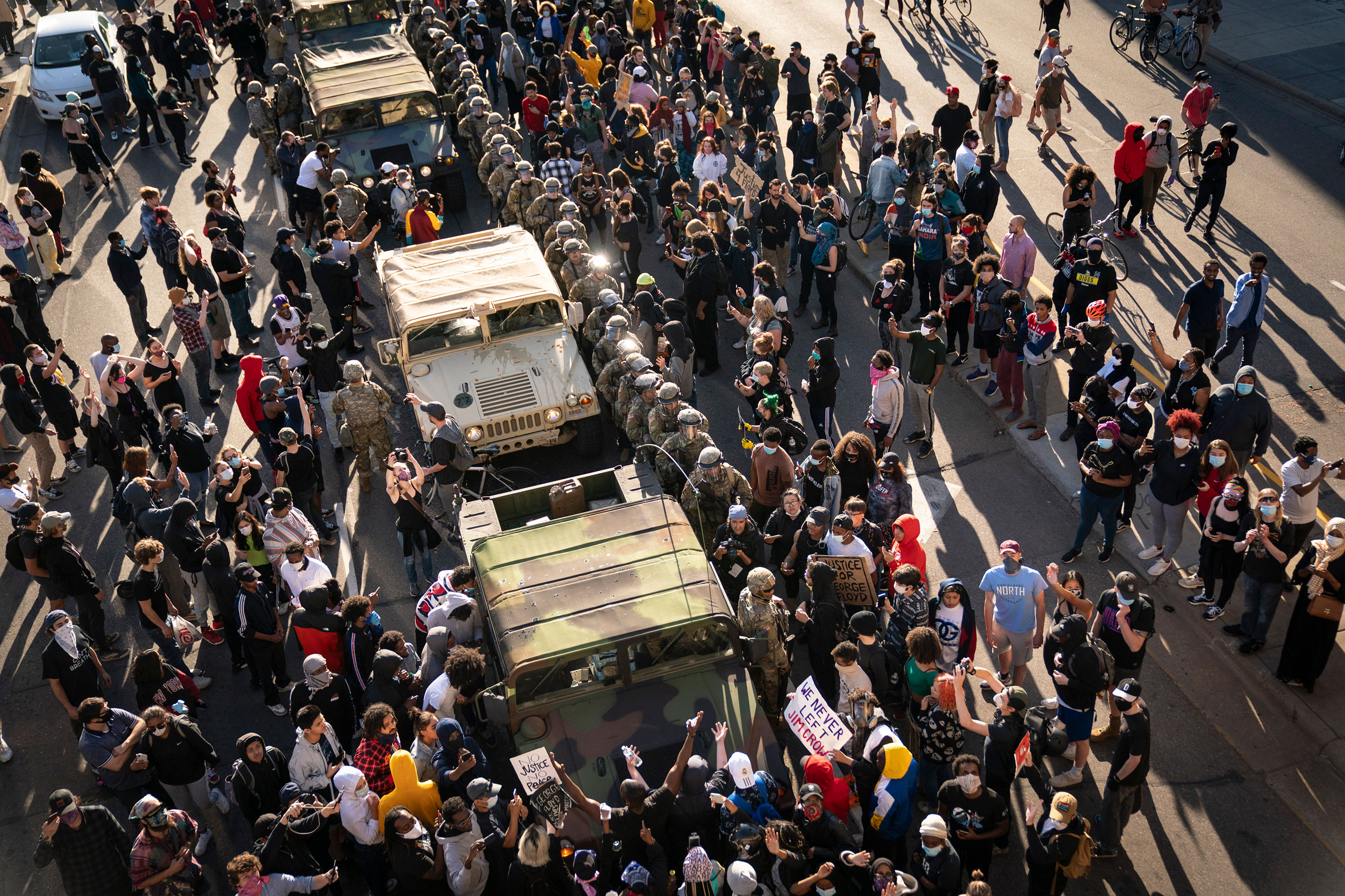 A group of protesters surround several National Guard vehicles on Lake Street in Minneapolis on May 29.