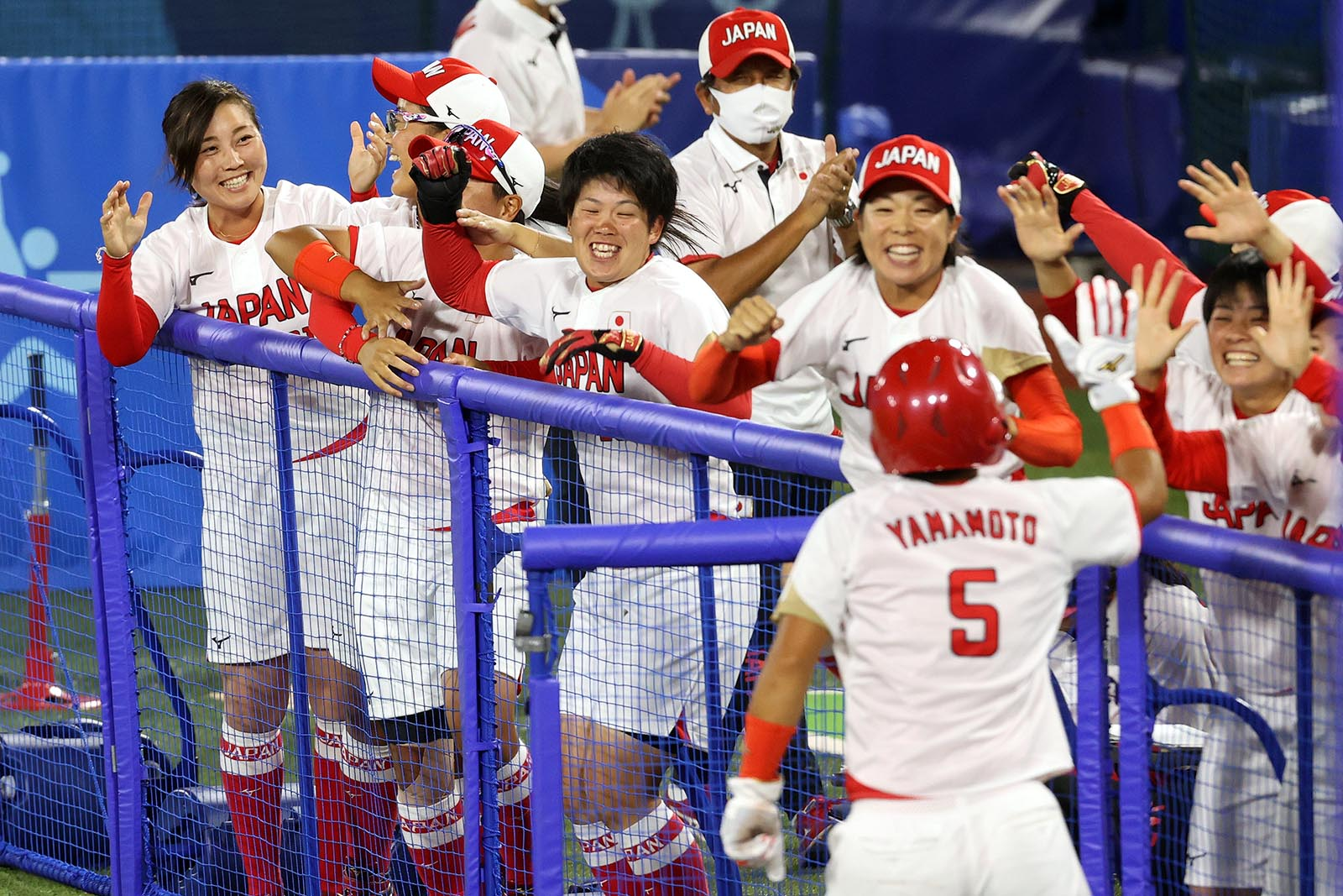 Yu Yamamoto #5 of Team Japan returns to the dugout after scoring in the fifth inning against Team USA during the softball final on July 27, in Yokohama, Japan.