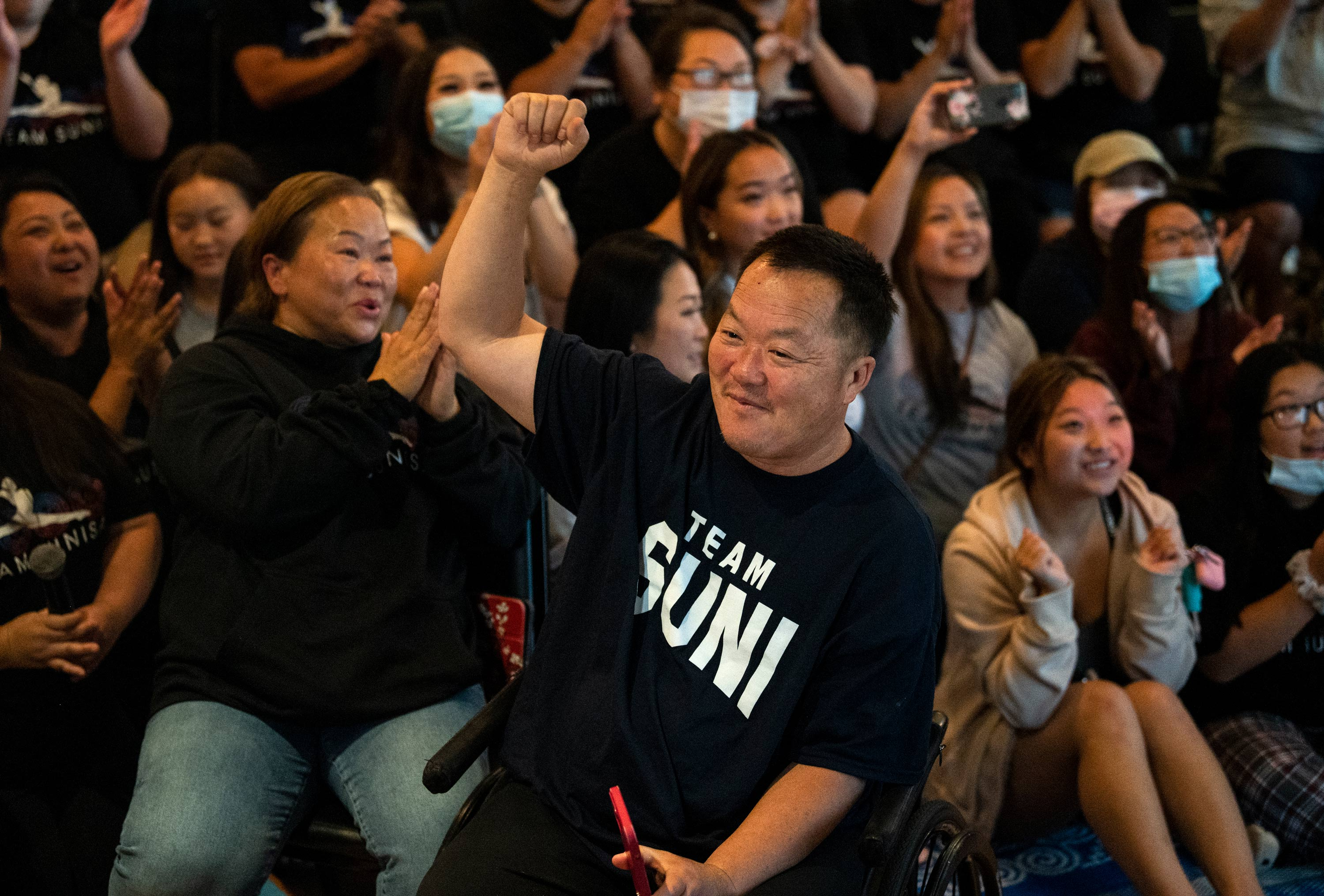 John Lee, father of Sunisa Lee of Team United States, celebrates at a watch party in Oakdale, Minnesota, after Sunisa won gold in the all-around gymnastics final on July 29.