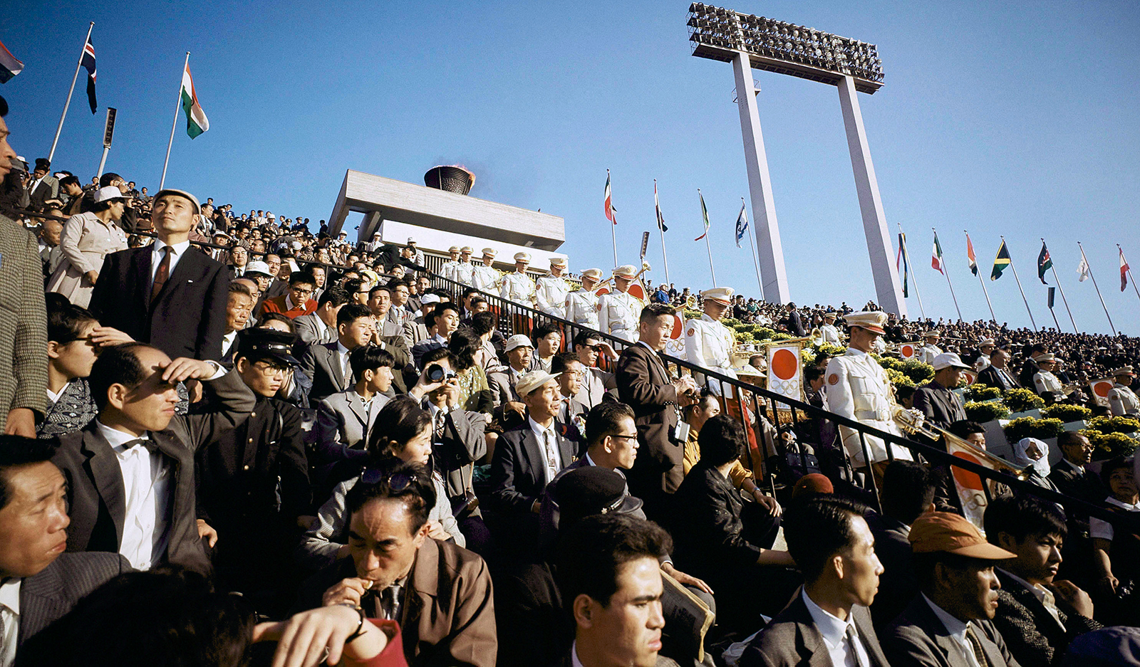 People attend the opening ceremony of the 1964 Tokyo Olympics.