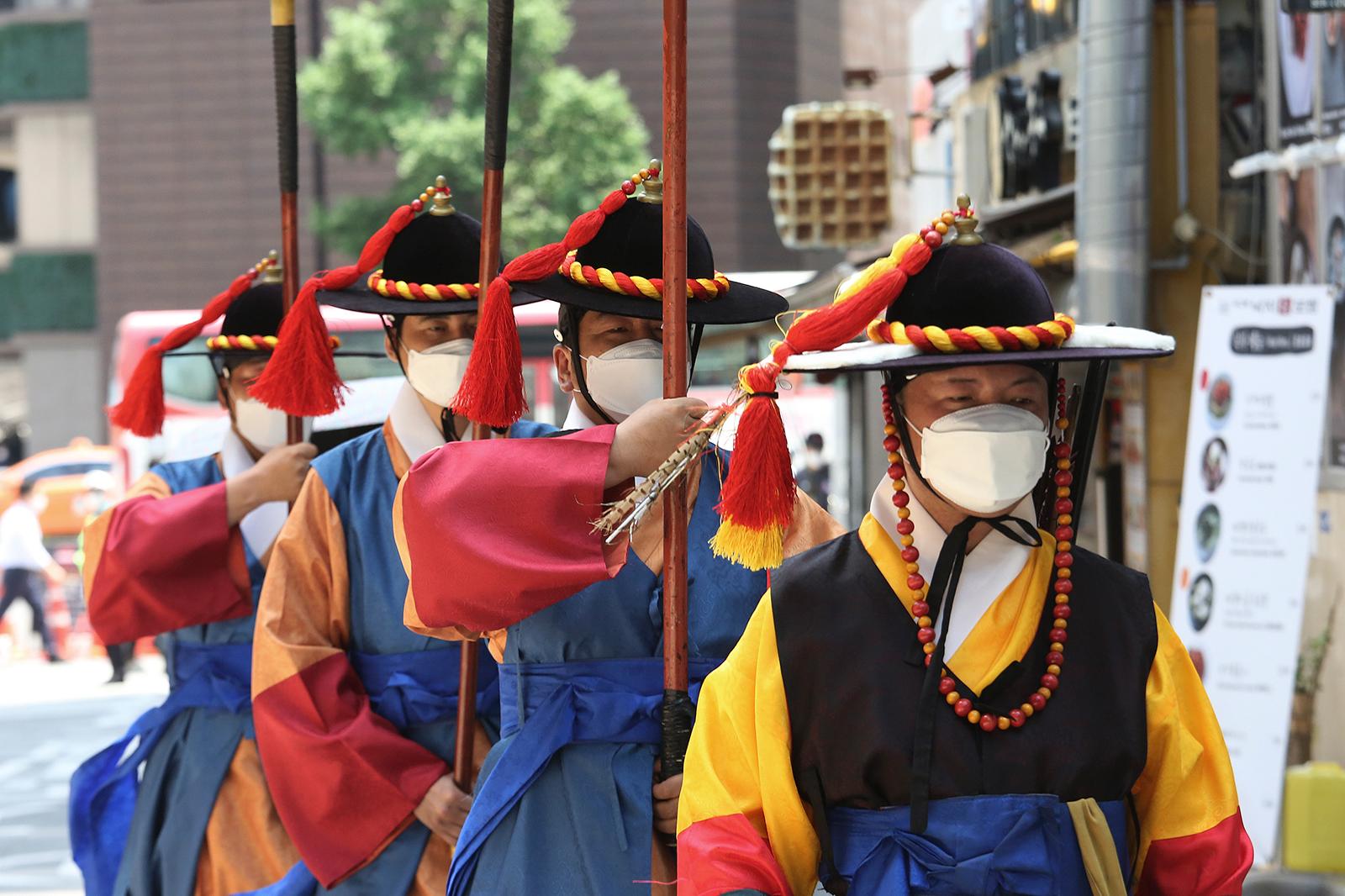 South Korean Imperial guards wear face masks near the Deoksu Palace in Seoul, South Korea, on July 3.