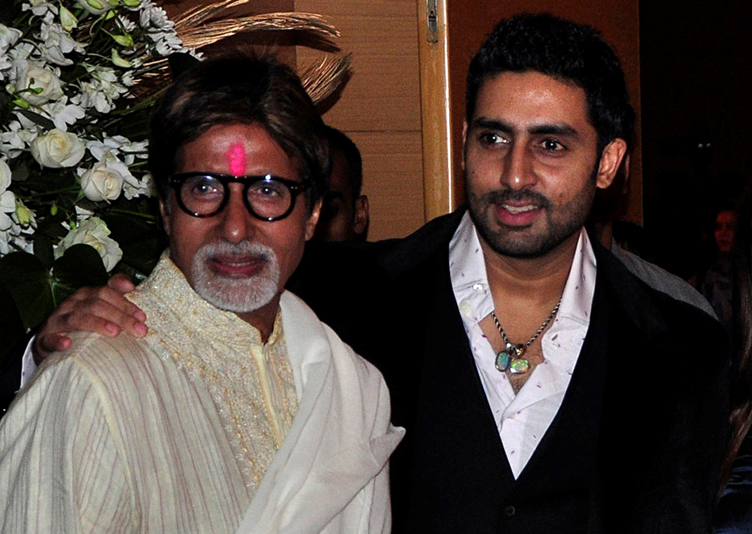 Bollywood actors Amitabh Bachchan, left, and his son Abhishek Bachchan attend a Bollywood party in Mumbai on February 28, 2010.