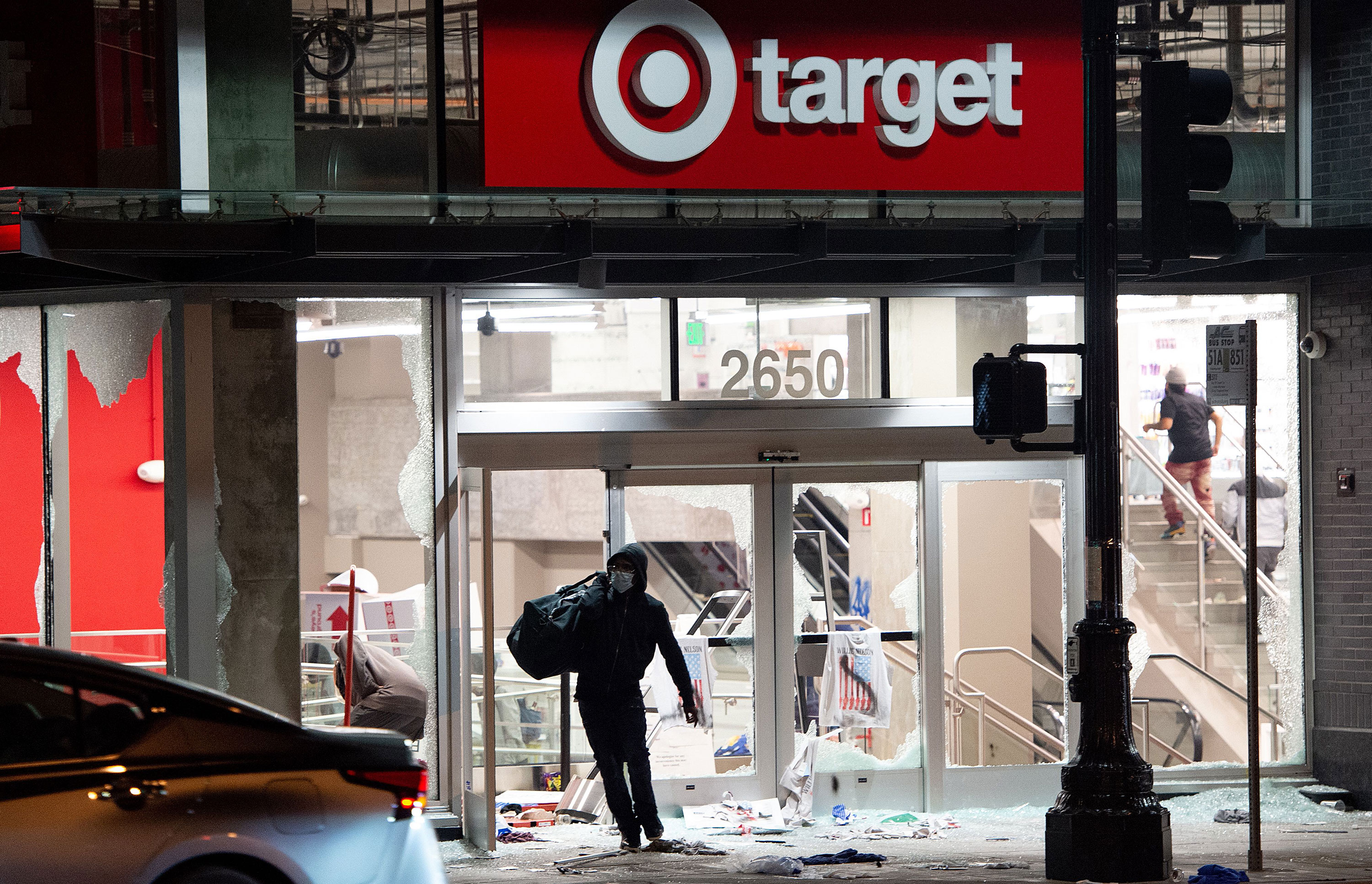 A looter leaves a Target store in Oakland, California, on May 30.