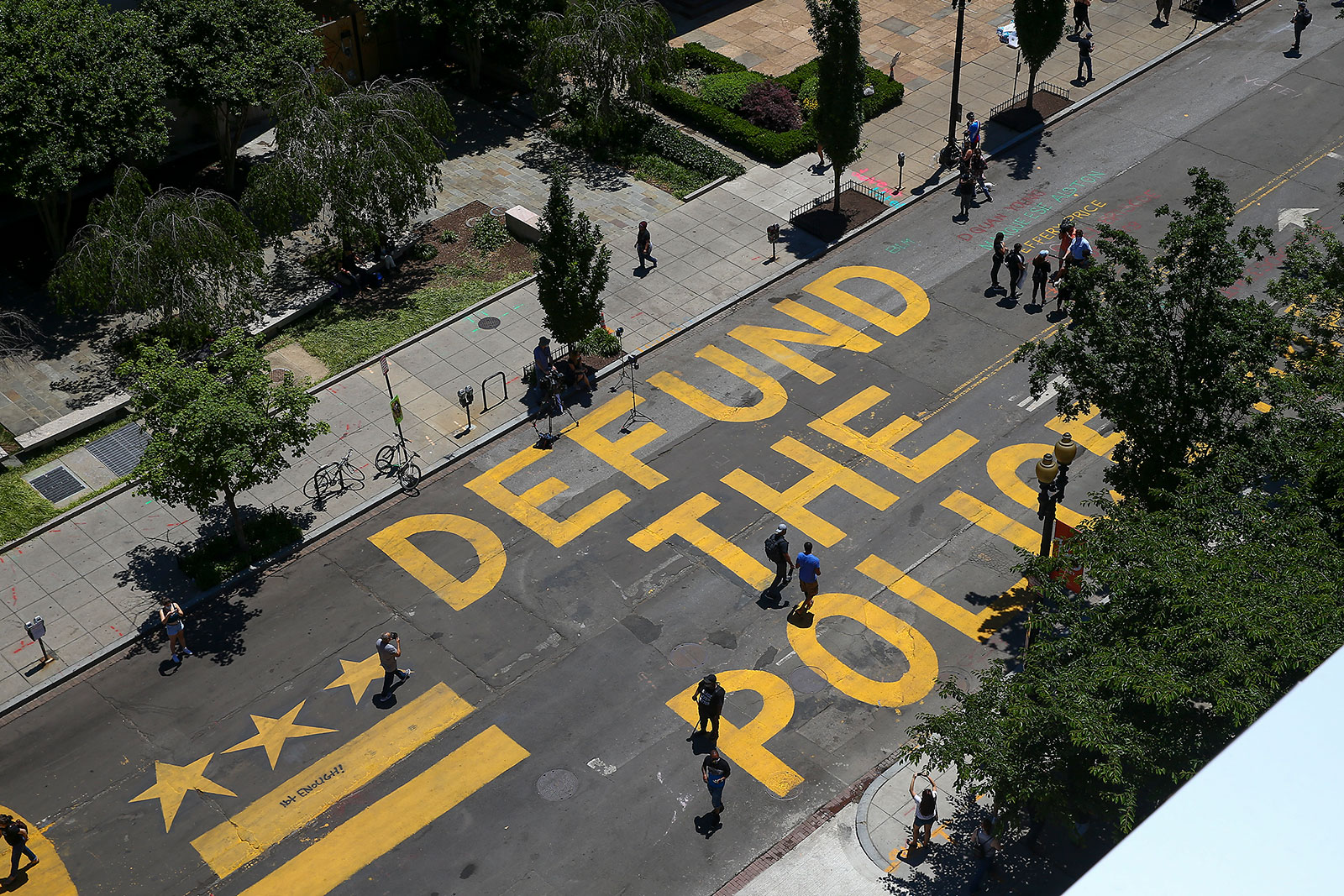 """The words """"Defund The Police"""" are seen painted on Black Lives Matter Plaza in Washington."""