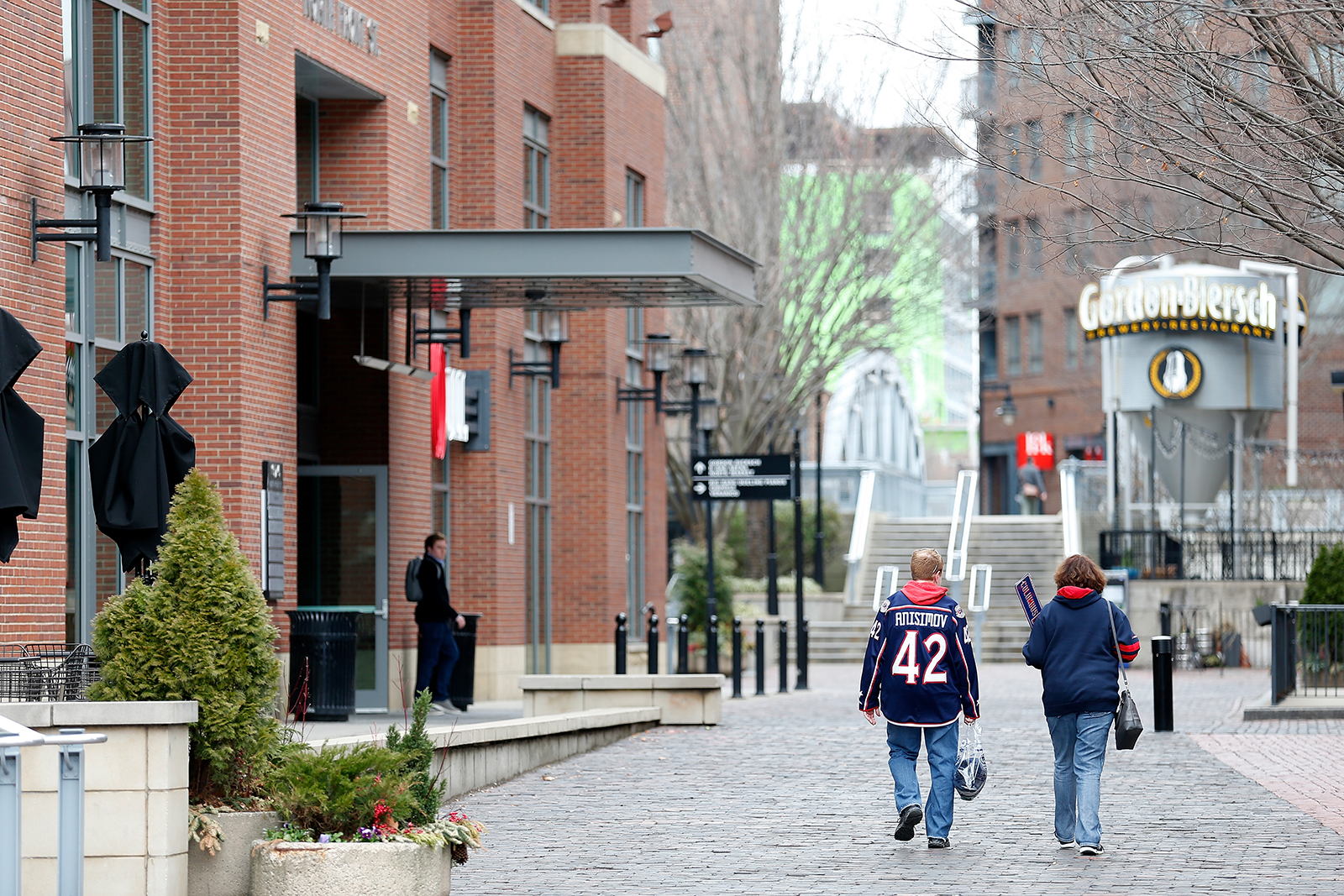 A pair of fans walk down an empty walkway at the Nationwide Arena in Columbus, Ohio, on March 12. The game between the Columbus Blue Jackets and the Pittsburgh Penguins was canceled after the NHL's decision to suspend the remaining games in the season due to the continuing outbreak of the coronavirus (COVID-19).