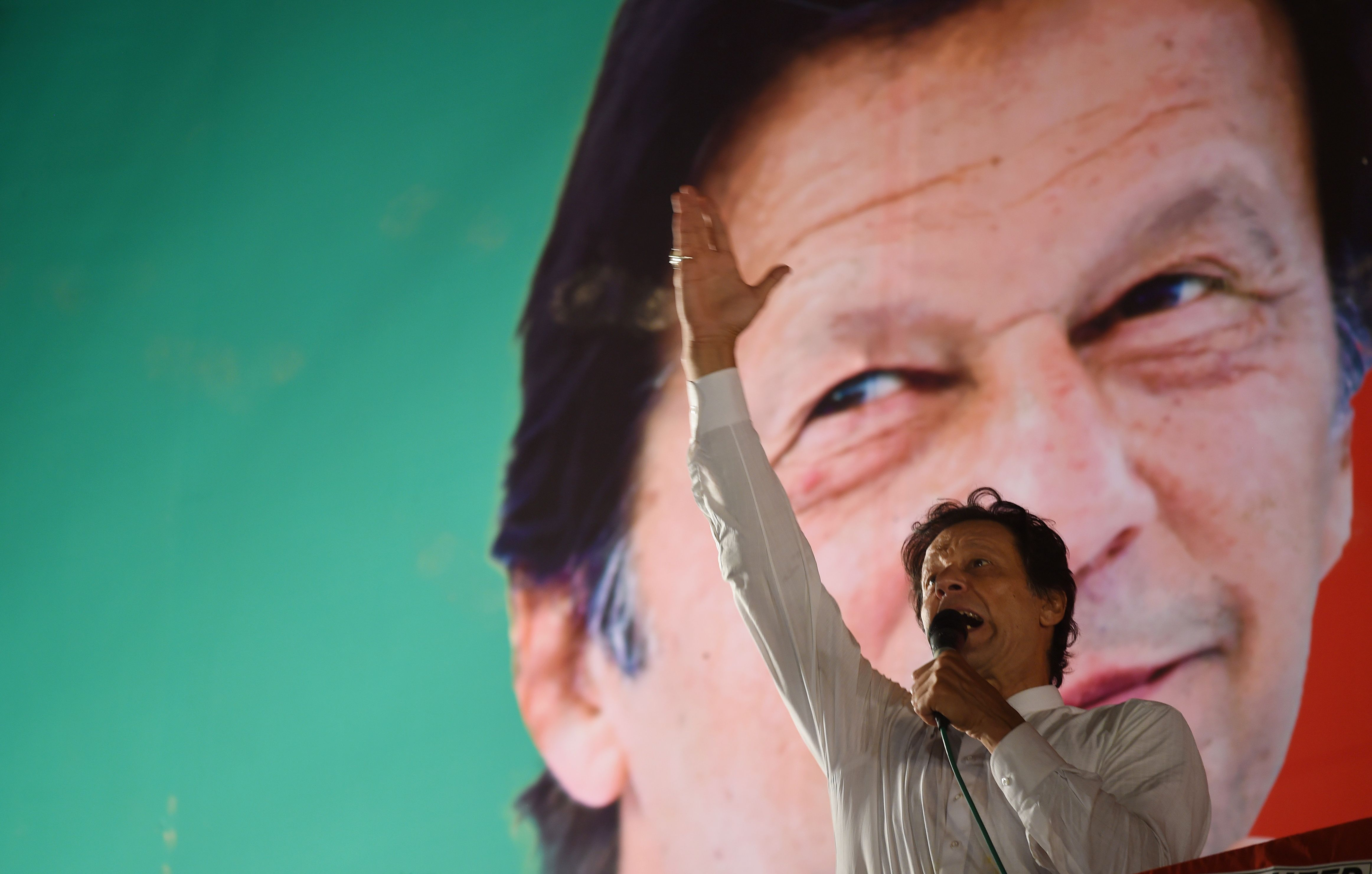 Pakistani cricket star-turned-politician and head of the Pakistan Tehreek-e-Insaf (PTI) Imran Khan gestures as he delivers a speech during a political campaign rally, in Islamabad, on July 21, 2018.