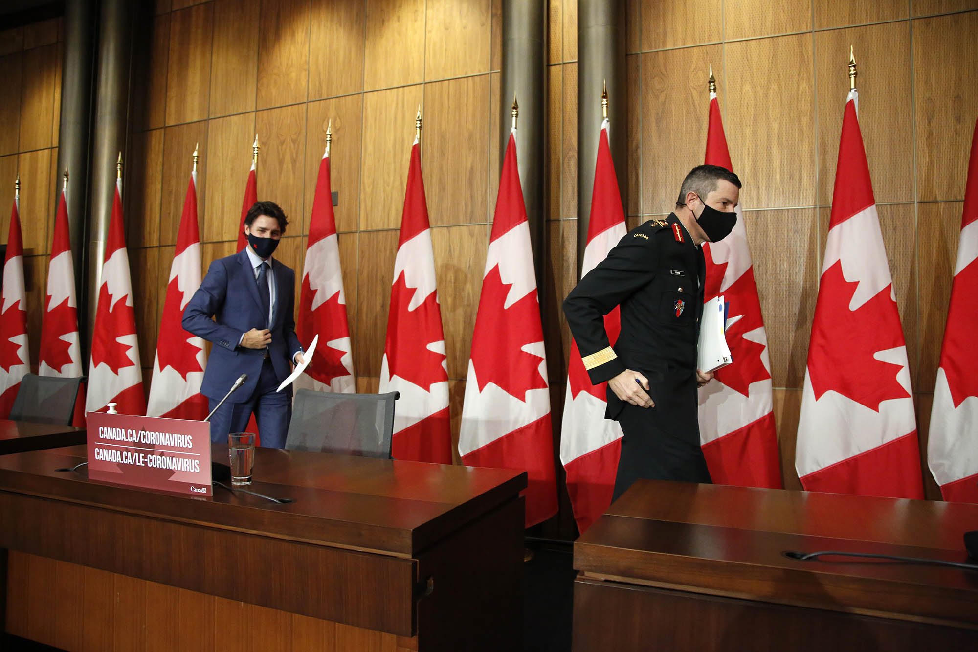 Canada prime minister Justin Trudeau, left, and Major General Dany Fortin, vice president of logistics and operations at Public Health Agency of Canada (PHAC), depart following a news conference in Ottawa, Ontario, Canada, on Thursday, December 10.