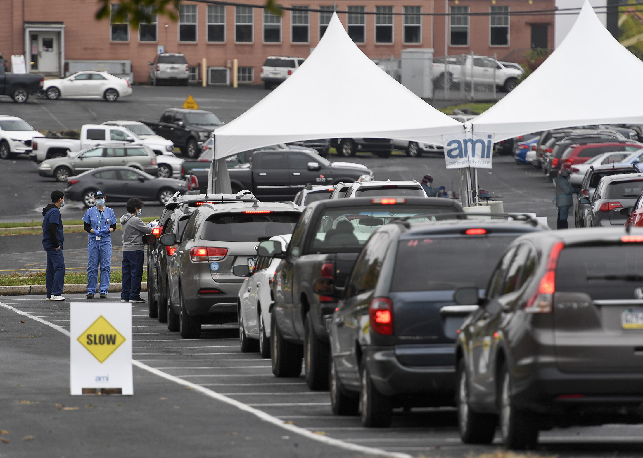 People wait in line for COVID-19 testing outside of the FirstEnergy Stadium in Reading, Pennsylvania, on October 13.