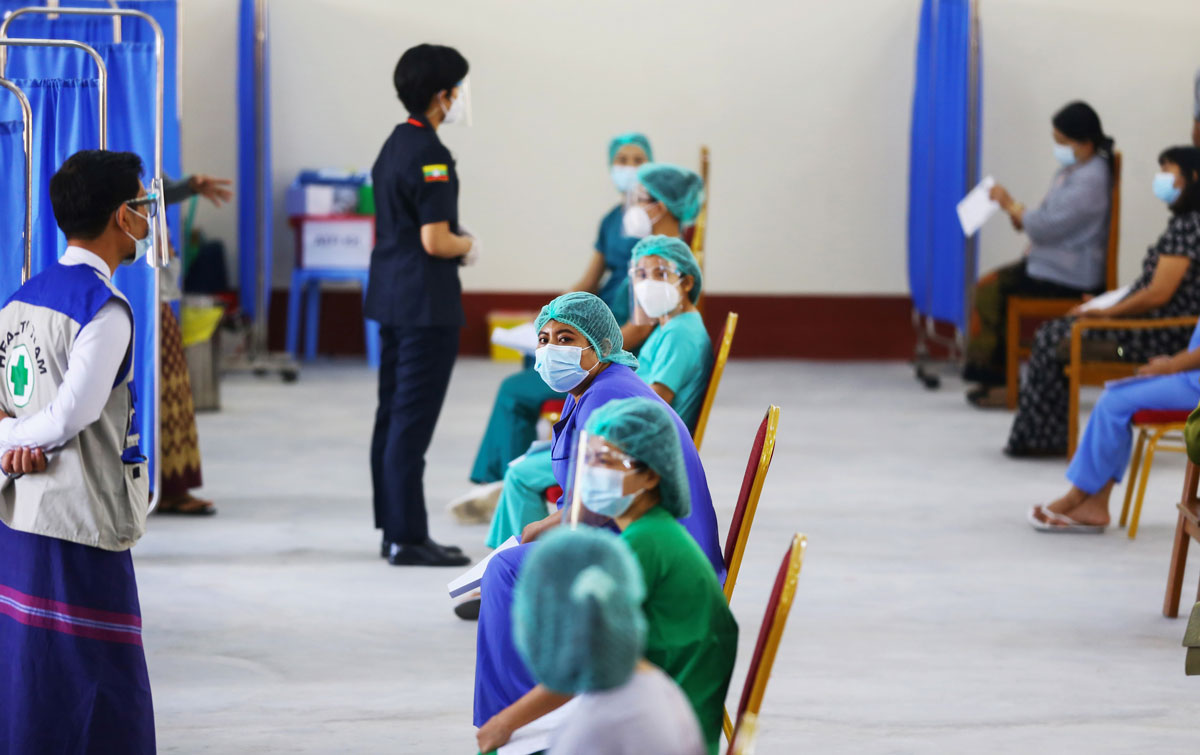 Health workers wait to receive a vaccine for the Covid-19 coronavirus at a hospital in Naypyidaw, Myanmar on January 27.