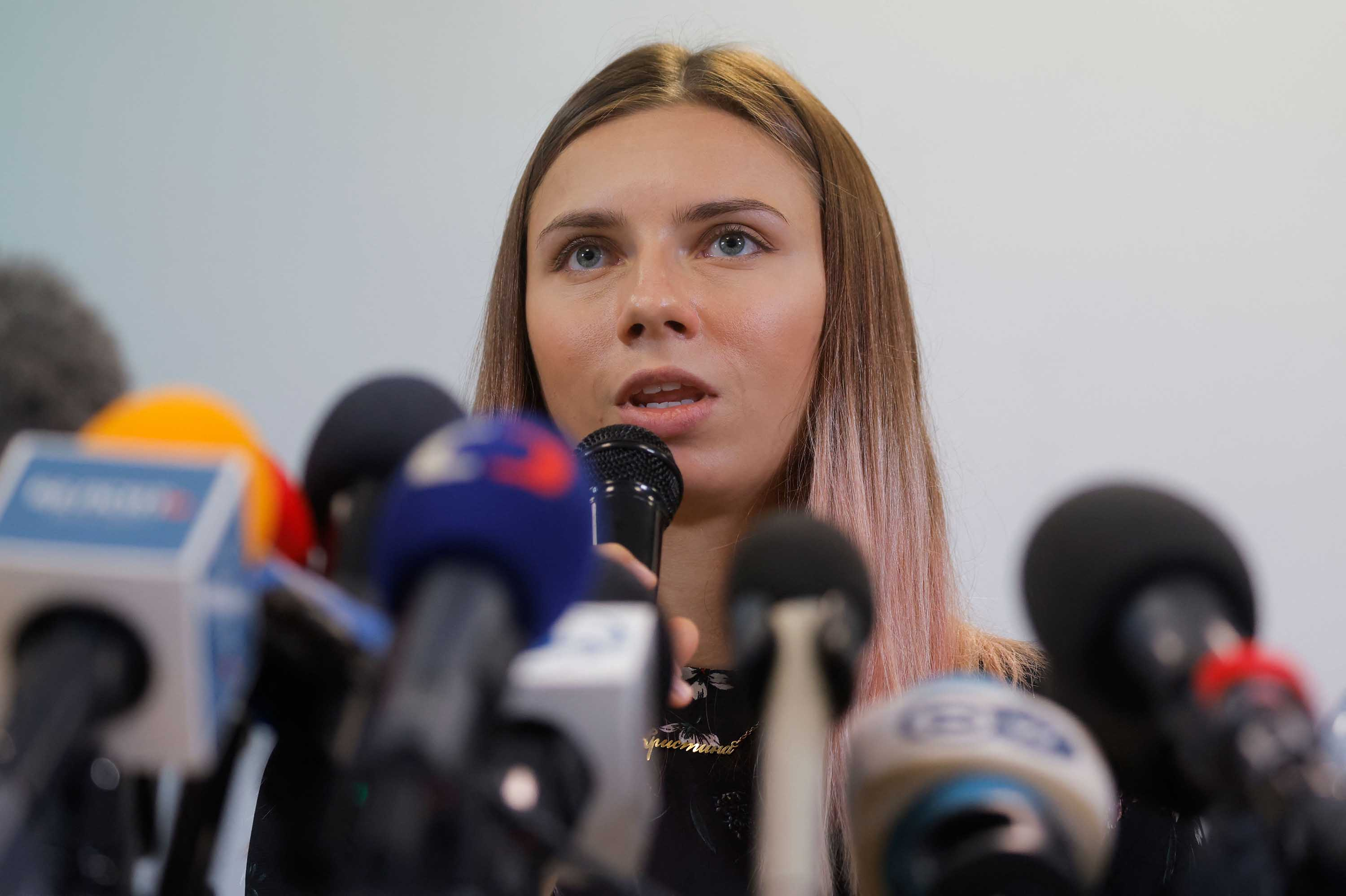 Belarusian Olympic athlete Kristina Timanovskaya addresses a press conference on August 5, in Warsaw, Poland.