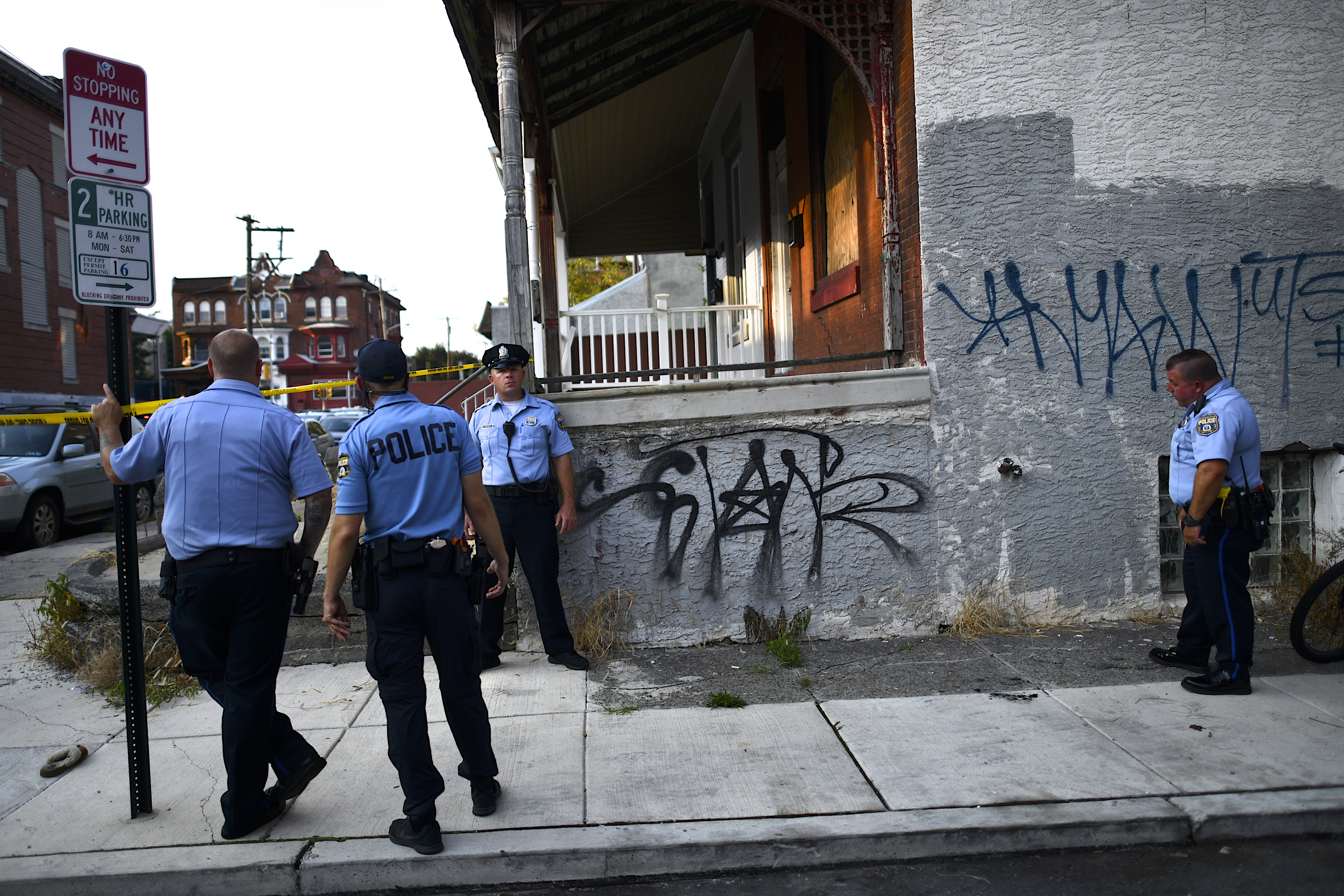 Police officers gather near the scene of a shooting on August 14, 2019 in Philadelphia, Pennsylvania.