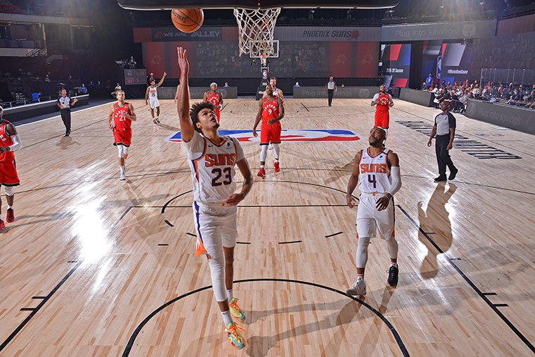 Cameron Johnson of the Phoenix Suns drives to the basket against the Toronto Raptors during a scrimmage on July 28, at The Arena at ESPN Wide World of Sports in Orlando, Florida.