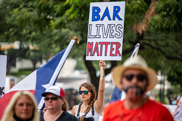 "A demonstrator holds up a sign during a ""Bar Lives Matter"" protest in Austin, Texas, on June 30. Gov. Greg Abbott's ordered to close bars on June 26."