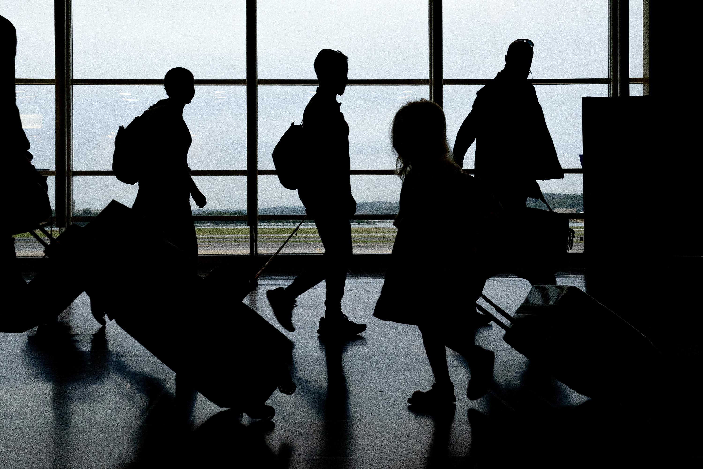 Travelers walk through Ronald Reagan National Airportin Arlington, Virginia, on May 25.