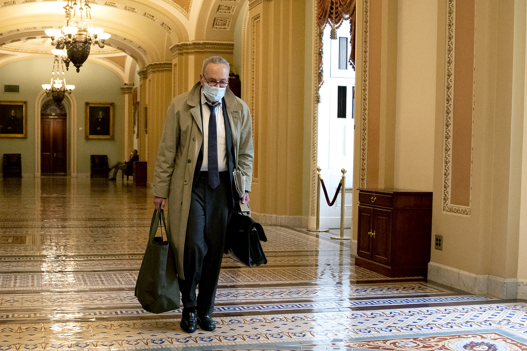 Senate Minority Leader Chuck Schumer wears a protective mask while arriving at the U.S. Capitol in Washington DC, on Monday, November 30, 2020.