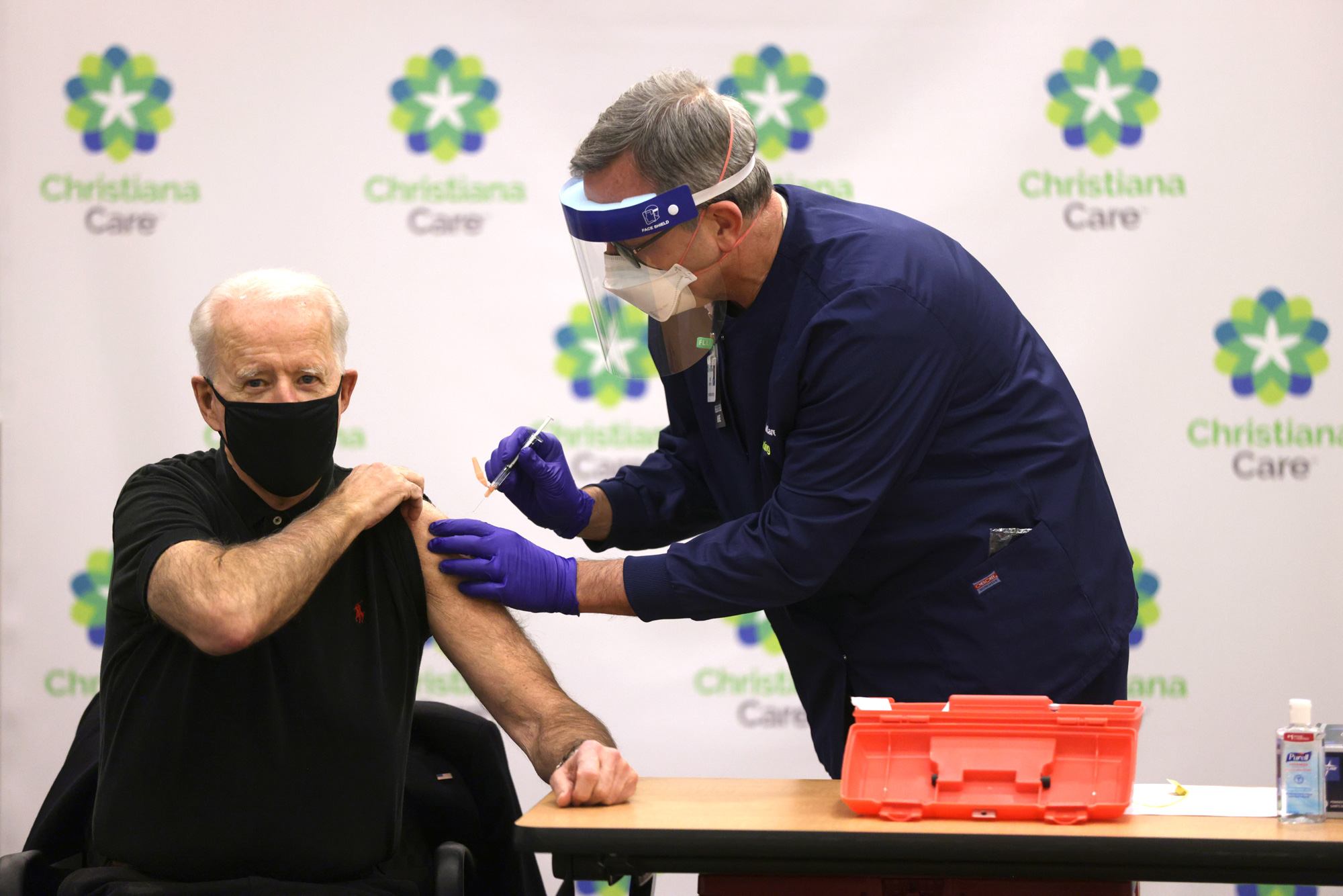President-elect Joe Biden, left receives the second dose of a COVID-19 Vaccination from Chief Nurse Executive Ric Cuming (R) at ChristianaCare Christiana Hospital on January 11, 2021 in Newark, Delaware.