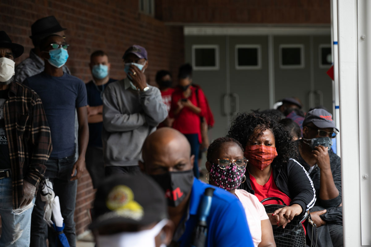 People wait in line on the first day of early voting for the general election at the C.T. Martin Natatorium and Recreation Center in Atlanta, Georgia on October 12.