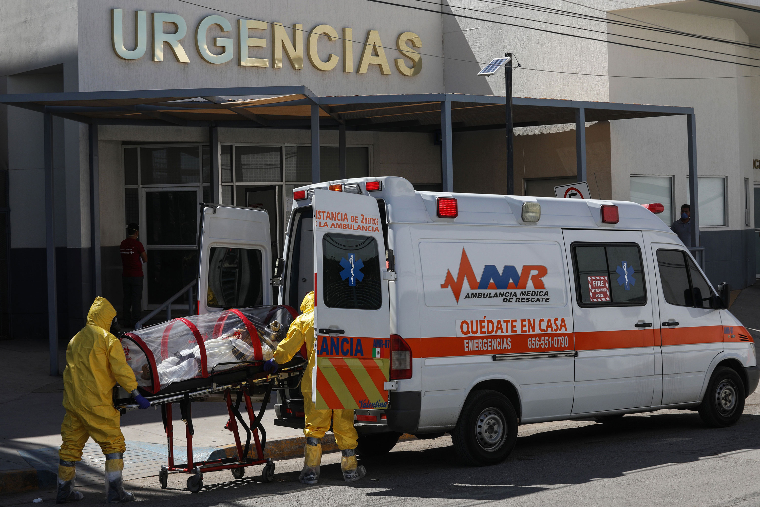 Paramedics transport a patient at the General Hospital in Ciudad Juarez, Mexico, on May 13.