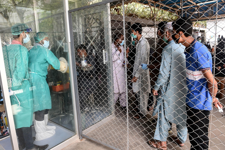 People wait in line to take a Covid-19 test in Karachi, Pakistan, on July 23.