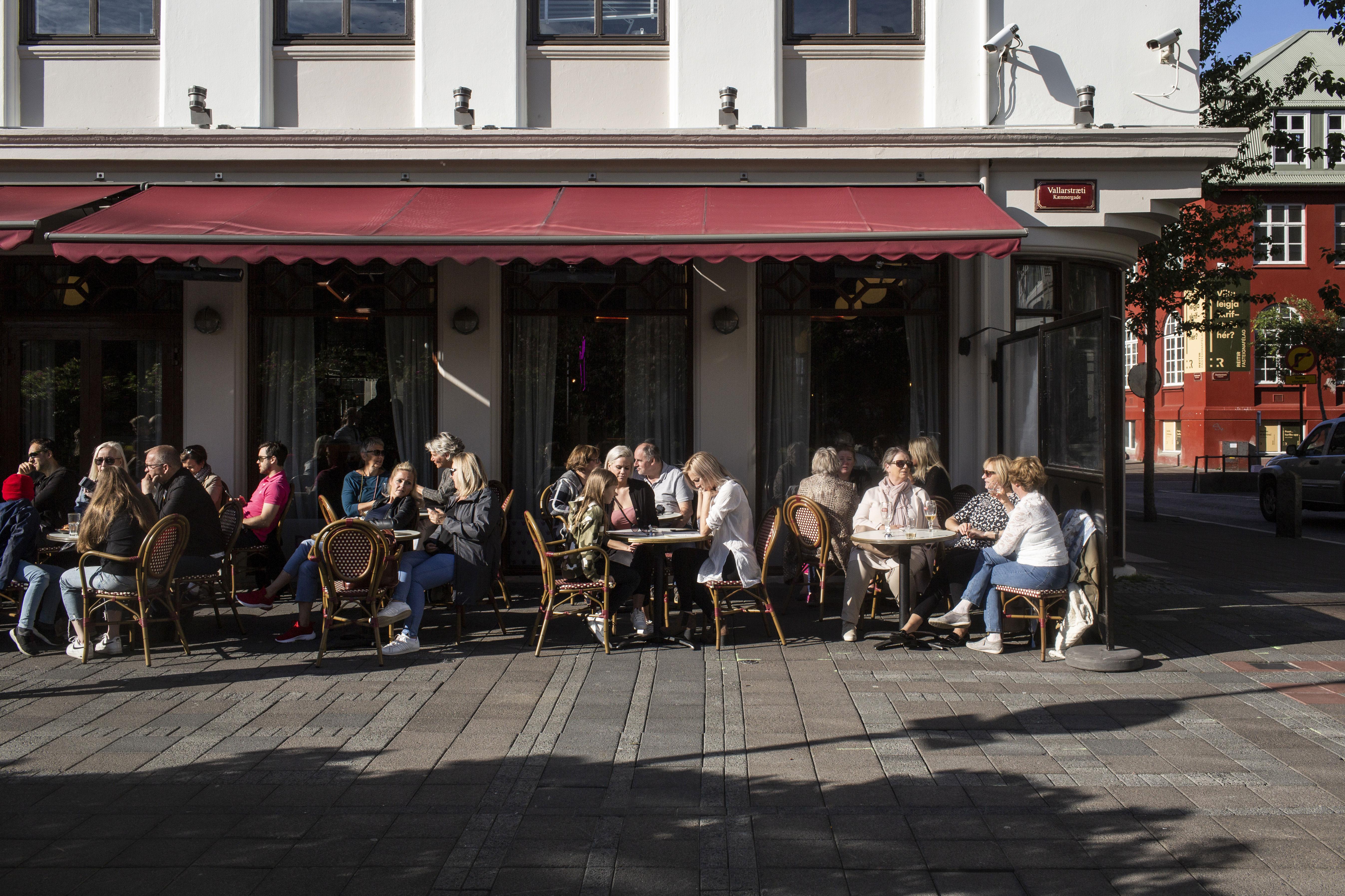 People dine at a restaurant in Reykjavík, Iceland, on July 19.