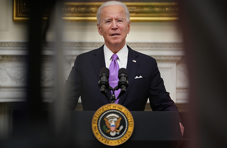 US President Joe Biden speaks about the Covid-19 response before signing executive orders in the State Dining Room of the White House in Washington, DC, on January 21, 2021.