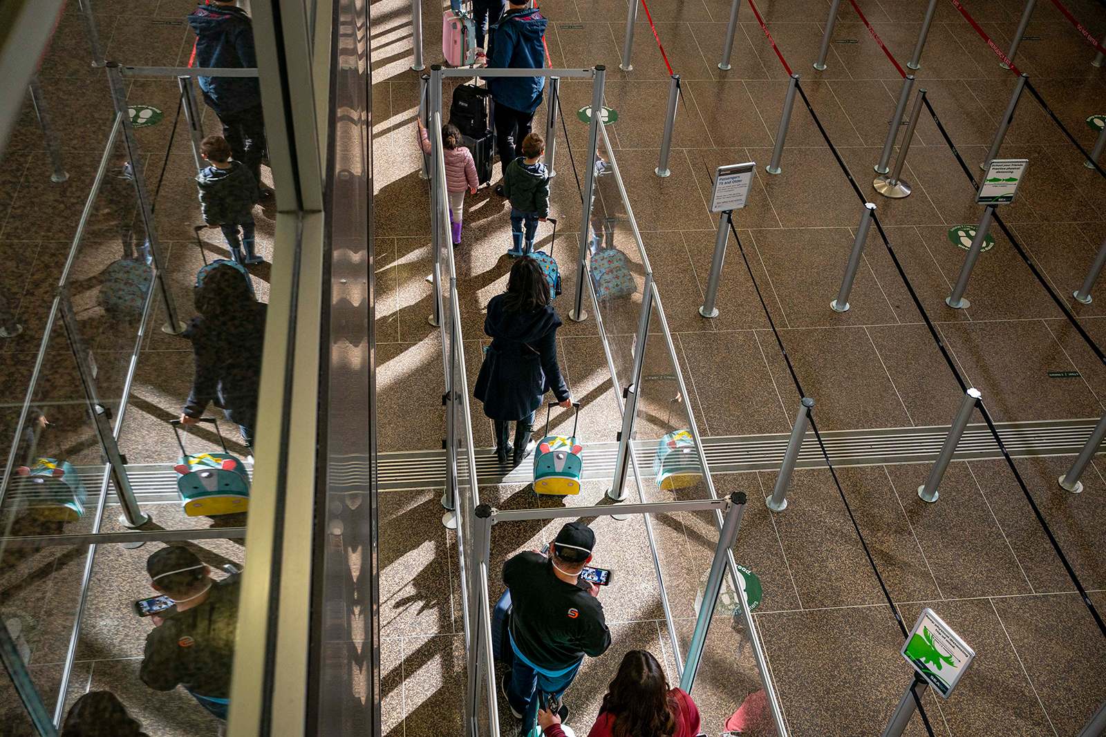 Travelers wait in line for security screening at Seattle-Tacoma International Airport in Seattle, on November 29.