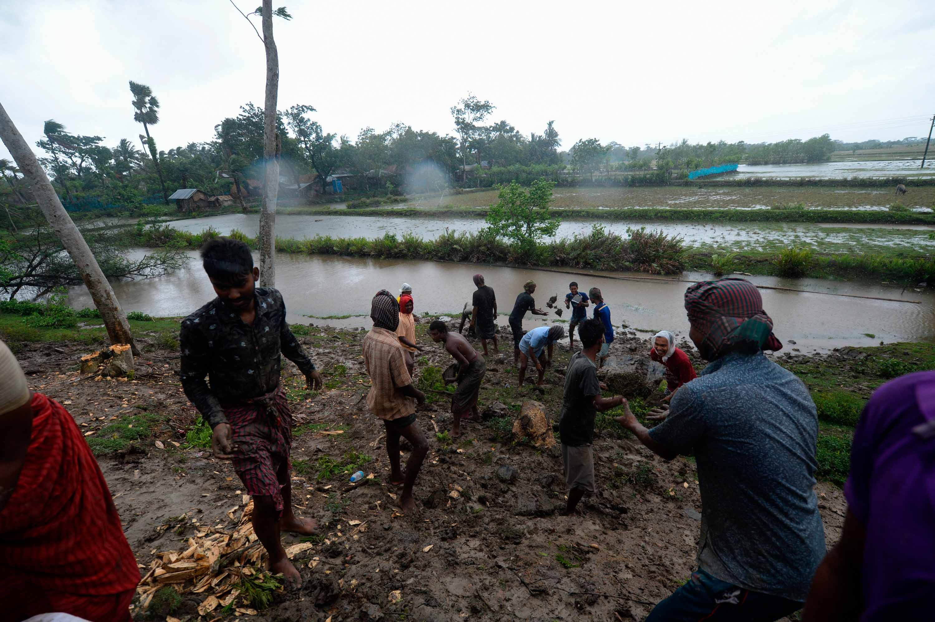 Villagers reinforce an embankment ahead of Cyclone Amphan's landfall in Dacope, Bangladesh, on May 20.