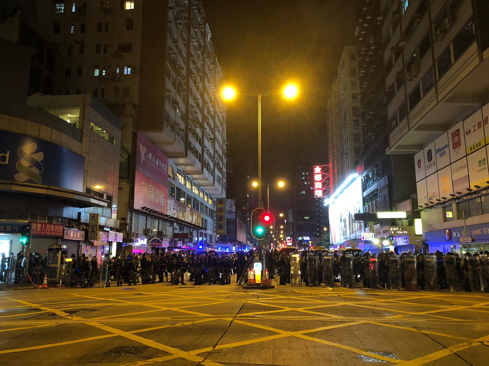 Police on Nathan Road, which has largely been cleared of protesters.